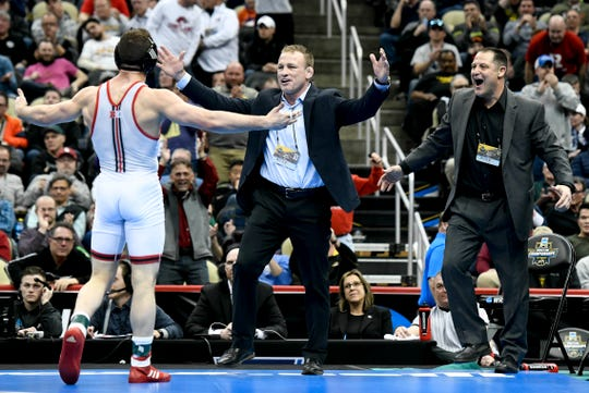 Mar 23, 2019; Pittsburgh, PA, USA; Rutgers senior Anthony Ashnault  celebrates with Rutgers coaching staff, including head coach Scott Goodale, right, after defeating Ohio State wrestler Micah Jordan in the finals of the 149 pound weight class during the NCAA Wrestling Championships at PPG Paints Arena. Ashnault is from South Plainfield.