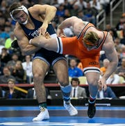 Mar 23, 2019; Pittsburgh, PA, USA; Oklahoma State wrestler Derek White (orange) wrestles Penn State wrestler Anthony Cassar (blue) in the finals of the 285 pound weight class during the NCAA Wrestling Championshipsat PPG Paints Arena. Cassar won the national title.