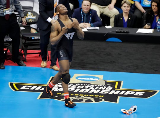 Virginia Tech's Mekhi Lewis celebrates his win over Penn State's Vincenzo Joseph in their 165-pound bout in the finals of the NCAA wrestling championships Saturday, March 23, 2019 in Pittsburgh. Lewis, of Bound Brook, went from the eighth seed to the top of the NCAA wrestling world as a redshirt freshman.