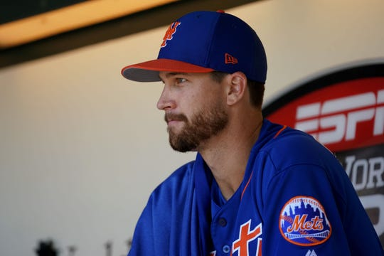 Mar 23, 2019; Lake Buena Vista, FL, USA; New York Mets starting pitcher Jacob deGrom (48) sits in the dugout prior to the game against the Atlanta Braves at Champion Stadium.
