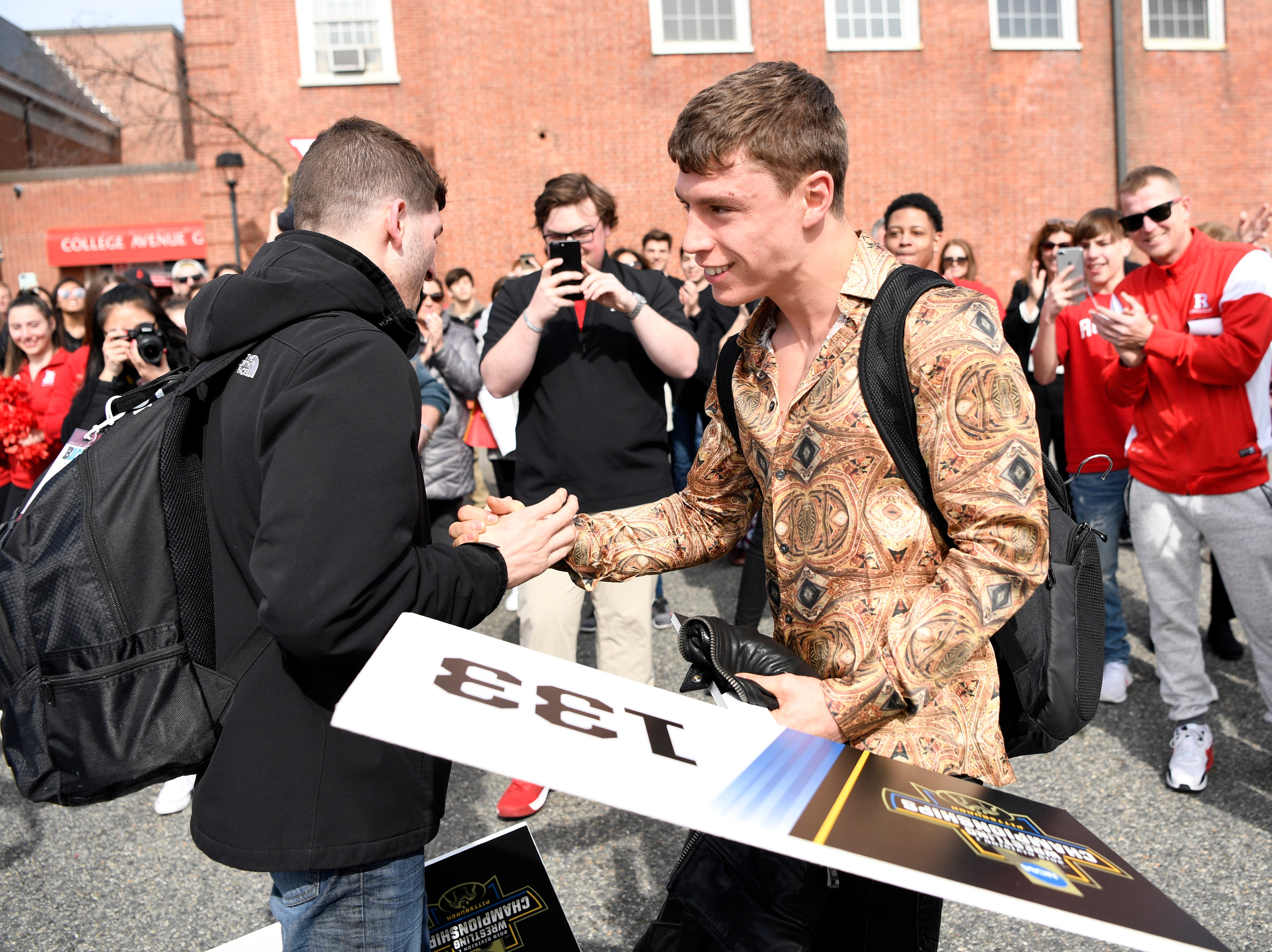 Rutgers wrestling: Champs Nick Suriano, Anthony Ashnault get College Avenue heroes' welcome