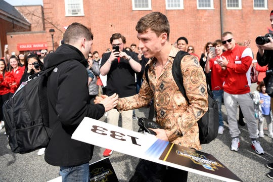 Rutgers wrestling champions Anthony Ashnault, left, and Nick Suriano shake hands as they arrive to a homecoming celebration on Sunday, March 24, 2019, in New Brunswick. Ashnault and Suriano secured the program's first individual titles at the 2019 NCAA Division I wrestling championships.