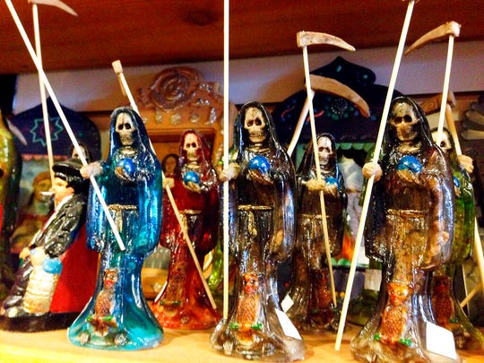 In this Feb. 13, 2013 file photo, statues of La Santa Muerte, an underworld saint most recently associated with the violent drug trade in Mexico, are shown at the Masks y Mas art store in Albuquerque, N.M. Santa Fe Archbishop John Wester recently told The Associated Press he believes some Catholics may be fooled into venerating Santa Muerte even though the focus on death runs counter to the church's teachings and she's not an official Catholic saint.