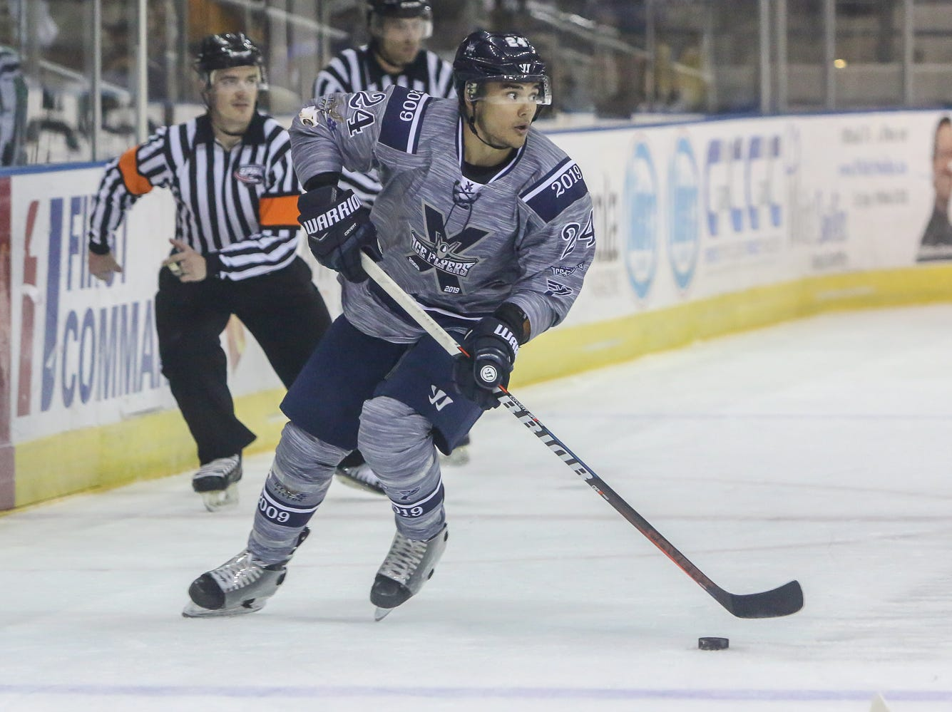 Pensacola's Eddie Matsushima (24) looks for an open teammate to pass the puck to against Macon during the last home game of the regular season at the Pensacola Bay Center on Saturday, March 23, 2019. With over 4,300 people in attendance for Pensacola's 3-1 victory, the Ice Flyers mark six straight years of over 100,000 people at their home games each season. The team has won their last five games in a row and will finish out their last five games on the road before entering the playoffs in a couple of weeks.