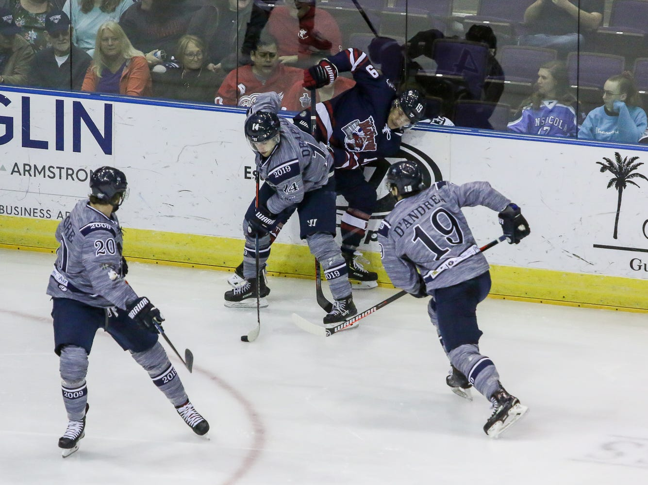 With Macon's Derek Sutliffe (19) pinned against the boards, Pensacola's Joseph Drapluk (14), Tim Moore (20), and Brett D'Andrea (19) work to clear the puck during the last home game of the regular season at the Pensacola Bay Center on Saturday, March 23, 2019. With over 4,300 people in attendance for Pensacola's 3-1 victory, the Ice Flyers mark six straight years of over 100,000 people at their home games each season. The team has won their last five games in a row and will finish out their last five games on the road before entering the playoffs in a couple of weeks.