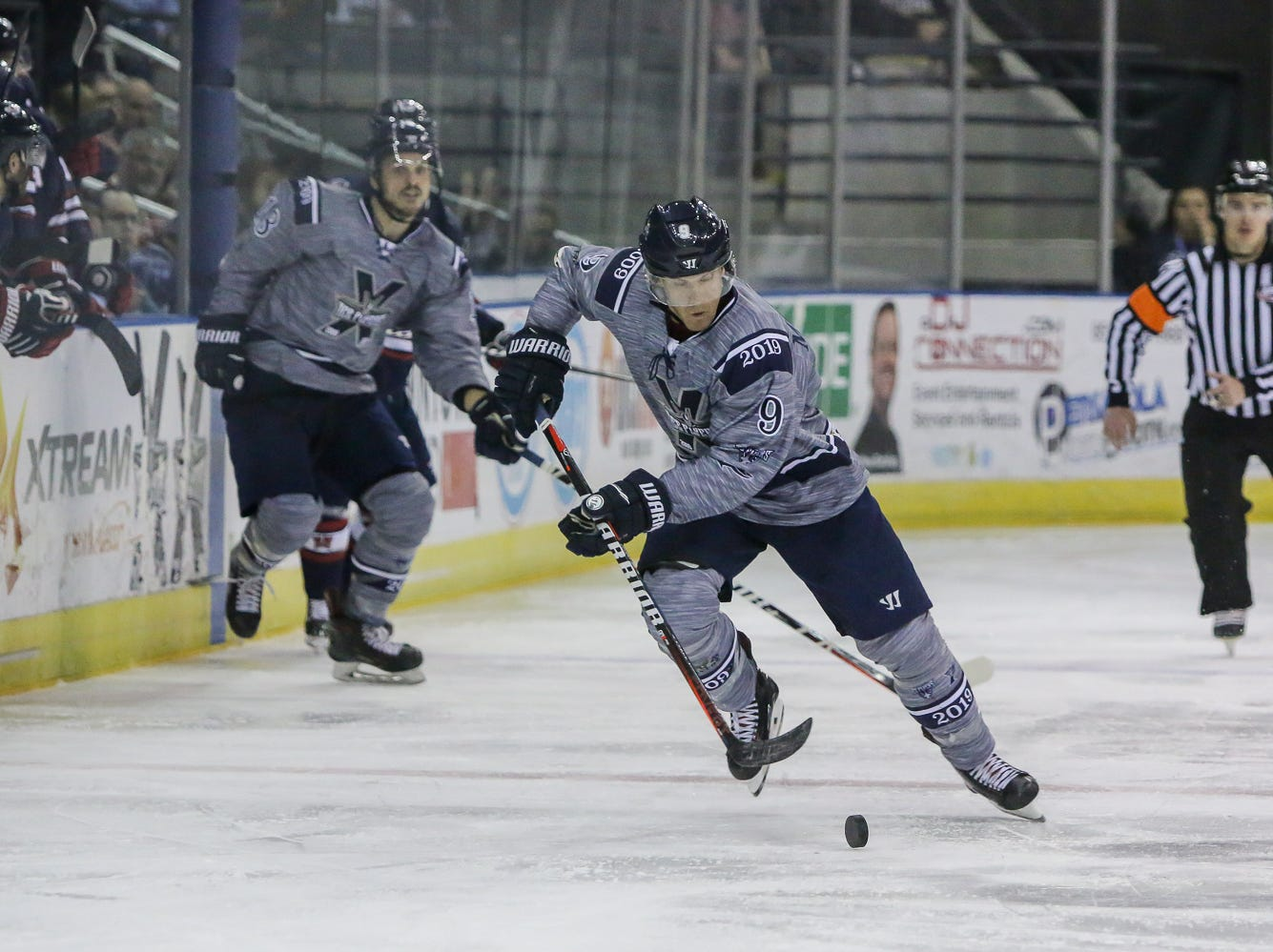 Pensacola's Ryan Marcuz (9) moves the puck up the ice against Macon during the last home game of the regular season at the Pensacola Bay Center on Saturday, March 23, 2019. With over 4,300 people in attendance for Pensacola's 3-1 victory, the Ice Flyers mark six straight years of over 100,000 people at their home games each season. The team has won their last five games in a row and will finish out their last five games on the road before entering the playoffs in a couple of weeks.