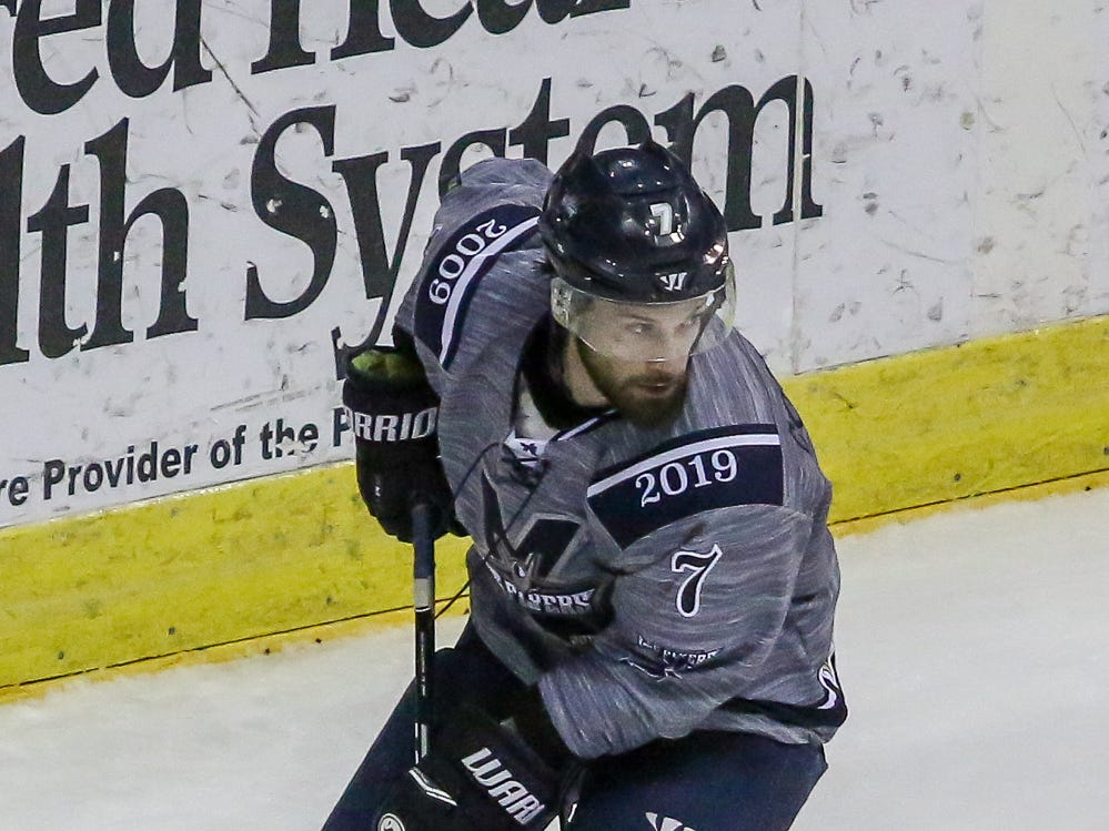 Pensacola's Josh Cousineau (7) moves the puck in from behind the Macon goal during the last home game of the regular season at the Pensacola Bay Center on Saturday, March 23, 2019. With over 4,300 people in attendance for Pensacola's 3-1 victory, the Ice Flyers mark six straight years of over 100,000 people at their home games each season. The team has won their last five games in a row and will finish out their last five games on the road before entering the playoffs in a couple of weeks.