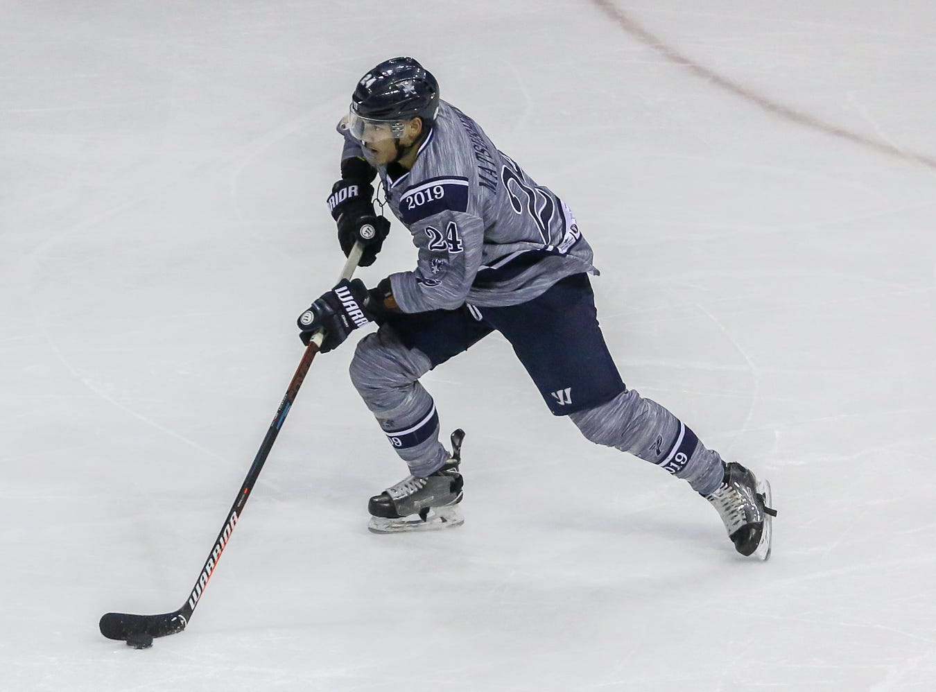 Pensacola's Eddie Matsushima (24) moves the puck up the ice against Macon during the last home game of the regular season at the Pensacola Bay Center on Saturday, March 23, 2019. With over 4,300 people in attendance for Pensacola's 3-1 victory, the Ice Flyers mark six straight years of over 100,000 people at their home games each season. The team has won their last five games in a row and will finish out their last five games on the road before entering the playoffs in a couple of weeks.