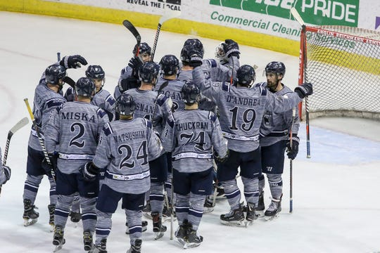 The Ice Flyers celebrate after beating Macon 3-1 during the last home game of the regular season at the Pensacola Bay Center on Saturday, March 23, 2019. With over 4,300 people in attendance for Pensacola's victory, the Ice Flyers mark six straight years of over 100,000 people at their home games each season. The team has won their last five games in a row and will finish out their last five games on the road before entering the playoffs in a couple of weeks.