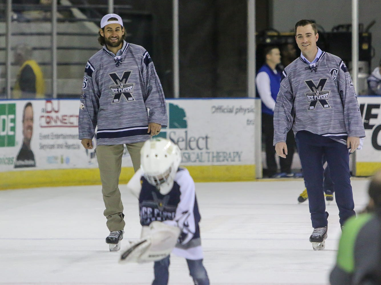 Former Ice Flyers players Drew Baker, left, and Adam Pawlick, right, skate around the ice during an intermission of the game against Macon at the Pensacola Bay Center on Saturday, March 23, 2019. They were among other former players and coaches recognized during the team's tenth anniversary weekend games last night and tonight.