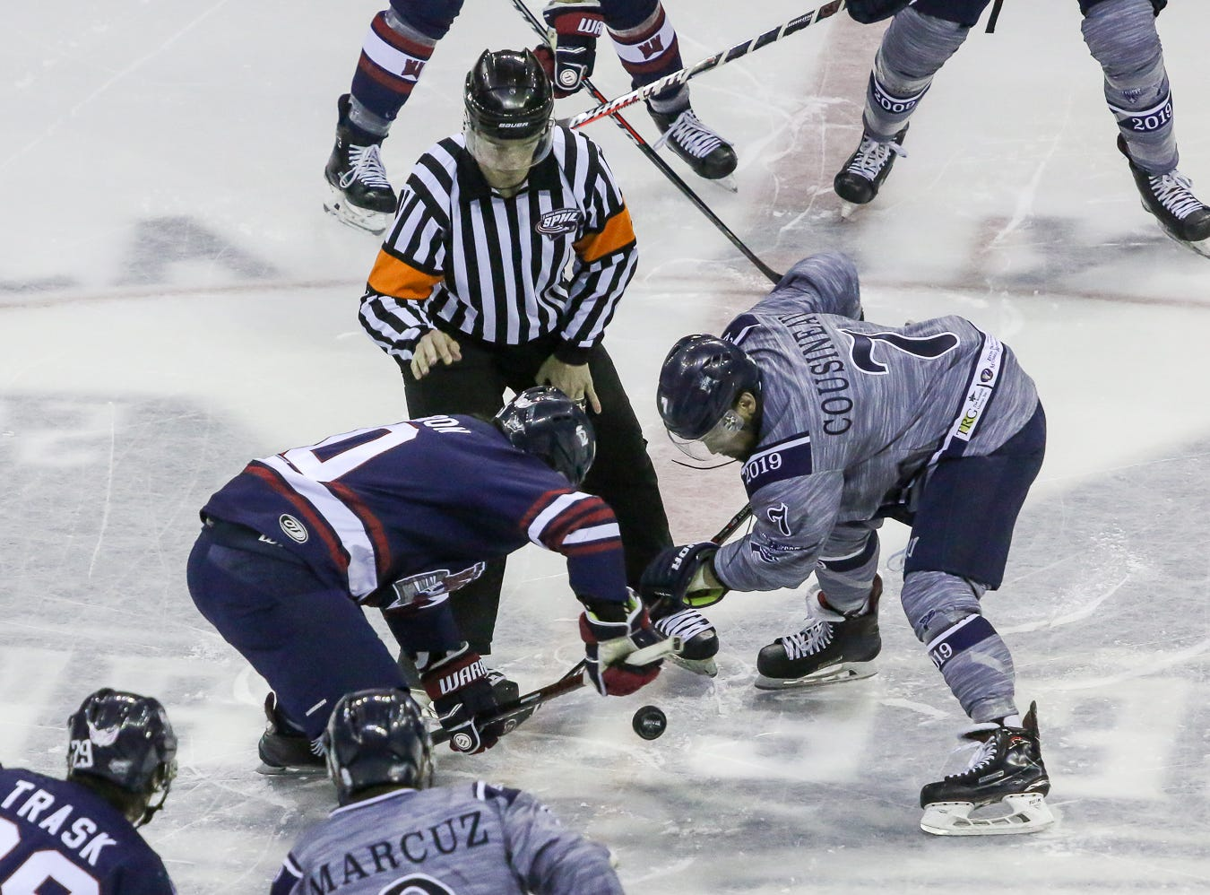 Pensacola's Josh Cousineau (7) takes the opening faceoff against Macon's Caleb Cameron (10) during the last home game of the regular season at the Pensacola Bay Center on Saturday, March 23, 2019. With over 4,300 people in attendance for Pensacola's 3-1 victory, the Ice Flyers mark six straight years of over 100,000 people at their home games each season. The team has won their last five games in a row and will finish out their last five games on the road before entering the playoffs in a couple of weeks.