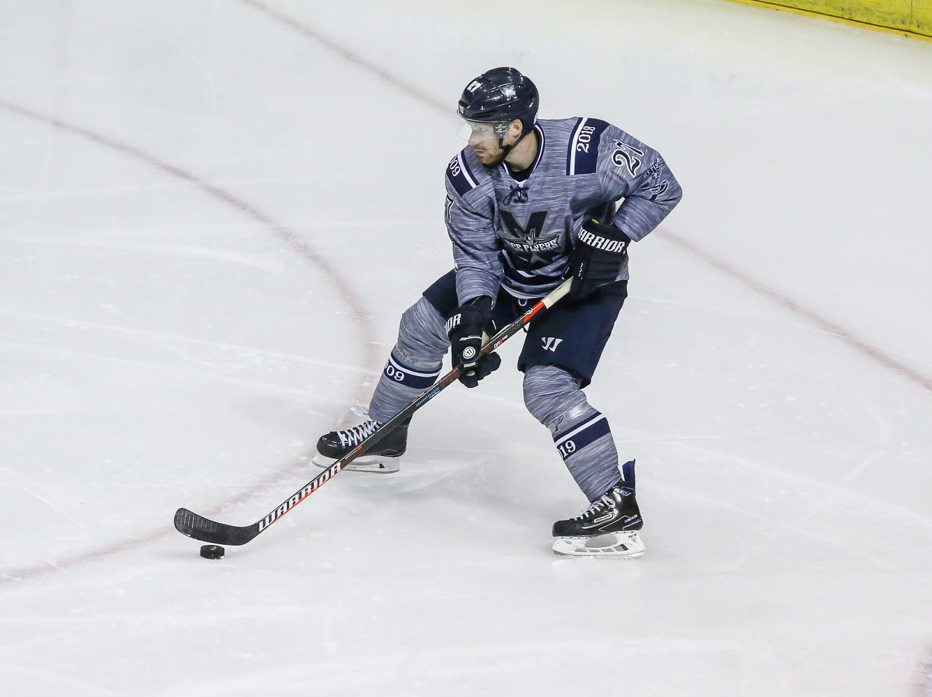 Pensacola's Jesse Kessler (27) looks to clear the puck against Macon during the last home game of the regular season at the Pensacola Bay Center on Saturday, March 23, 2019. With over 4,300 people in attendance for Pensacola's 3-1 victory, the Ice Flyers mark six straight years of over 100,000 people at their home games each season. The team has won their last five games in a row and will finish out their last five games on the road before entering the playoffs in a couple of weeks.