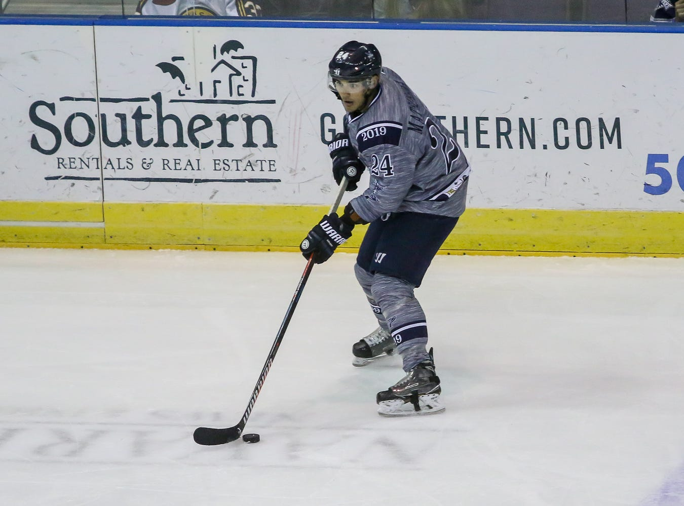 Pensacola's Eddie Matsushima (24) watches as his teammates set up a play against Macon during the last home game of the regular season at the Pensacola Bay Center on Saturday, March 23, 2019. With over 4,300 people in attendance for Pensacola's 3-1 victory, the Ice Flyers mark six straight years of over 100,000 people at their home games each season. The team has won their last five games in a row and will finish out their last five games on the road before entering the playoffs in a couple of weeks.