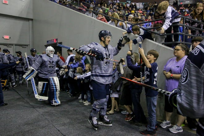 Fans cheer on the Ice Flyers after the first intermission of the last home game of the regular season at the Pensacola Bay Center on Saturday, March 23, 2019. With over 4,300 people in attendance for Pensacola's 3-1 victory, the Ice Flyers mark six straight years of over 100,000 people at their home games each season. The team has won their last five games in a row and will finish out their last five games on the road before entering the playoffs in a couple of weeks.