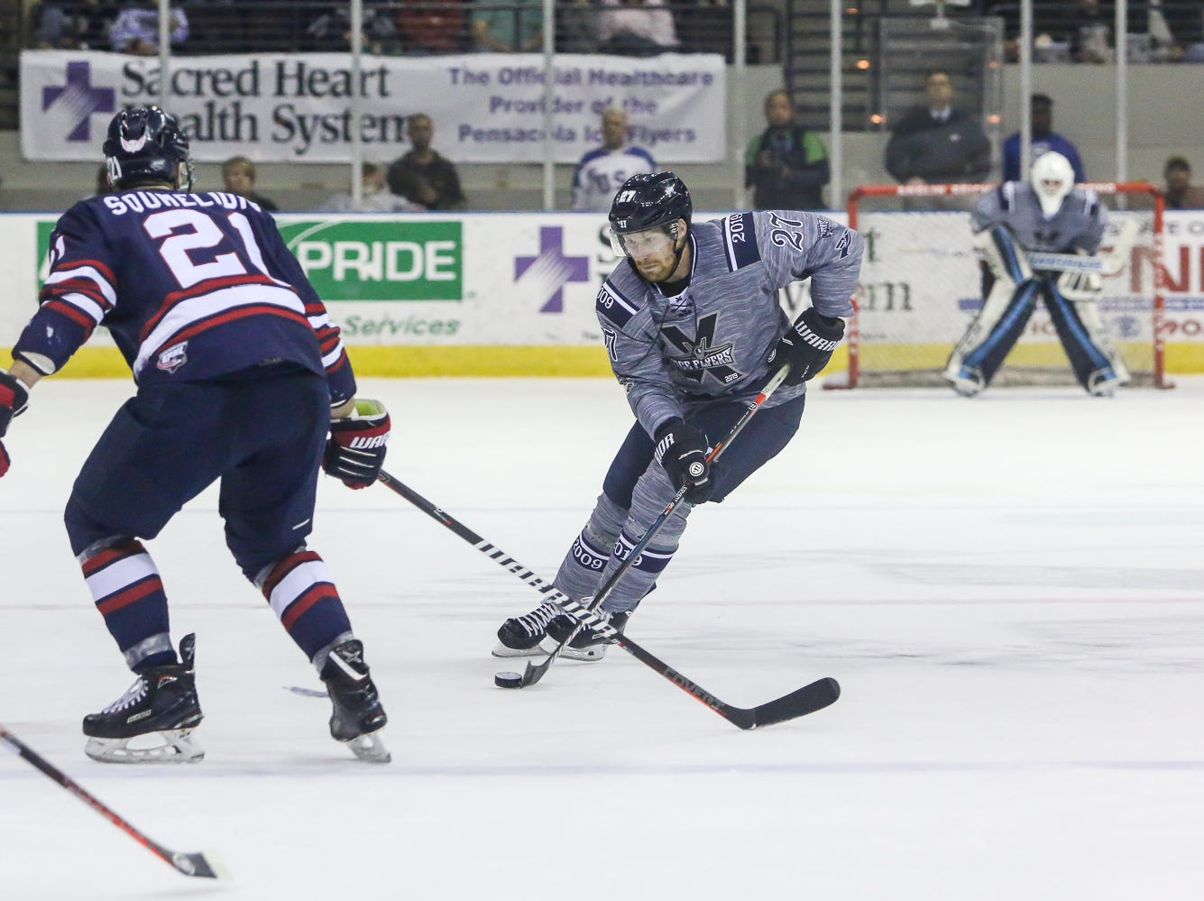 Pensacola's Jesse Kessler (27) moves the puck into the Macon zone during the last home game of the regular season at the Pensacola Bay Center on Saturday, March 23, 2019. With over 4,300 people in attendance for Pensacola's 3-1 victory, the Ice Flyers mark six straight years of over 100,000 people at their home games each season. The team has won their last five games in a row and will finish out their last five games on the road before entering the playoffs in a couple of weeks.