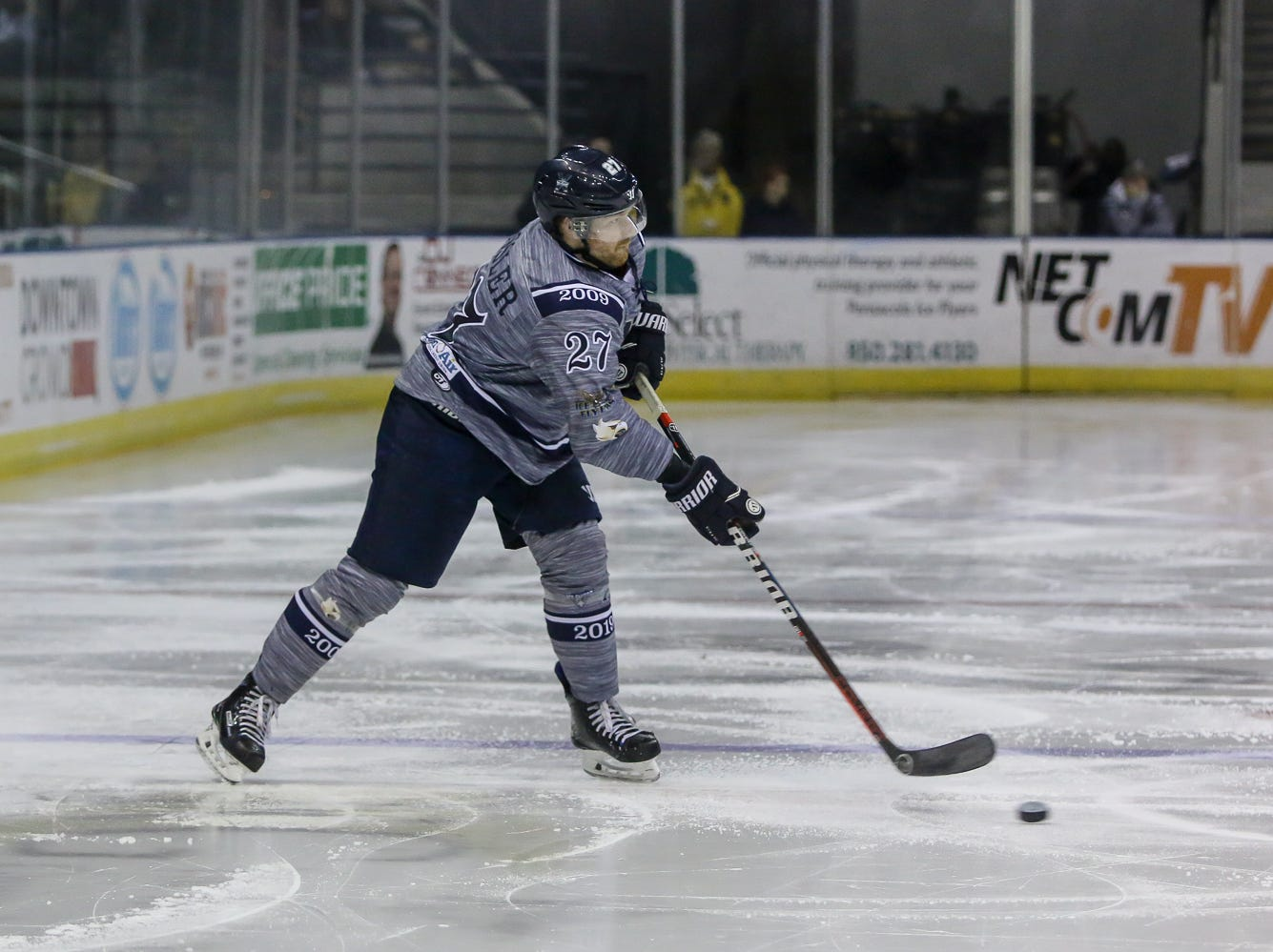 Pensacola's Jesse Kessler (27) passes the puck against Macon during the last home game of the regular season at the Pensacola Bay Center on Saturday, March 23, 2019. With over 4,300 people in attendance for Pensacola's 3-1 victory, the Ice Flyers mark six straight years of over 100,000 people at their home games each season. The team has won their last five games in a row and will finish out their last five games on the road before entering the playoffs in a couple of weeks.