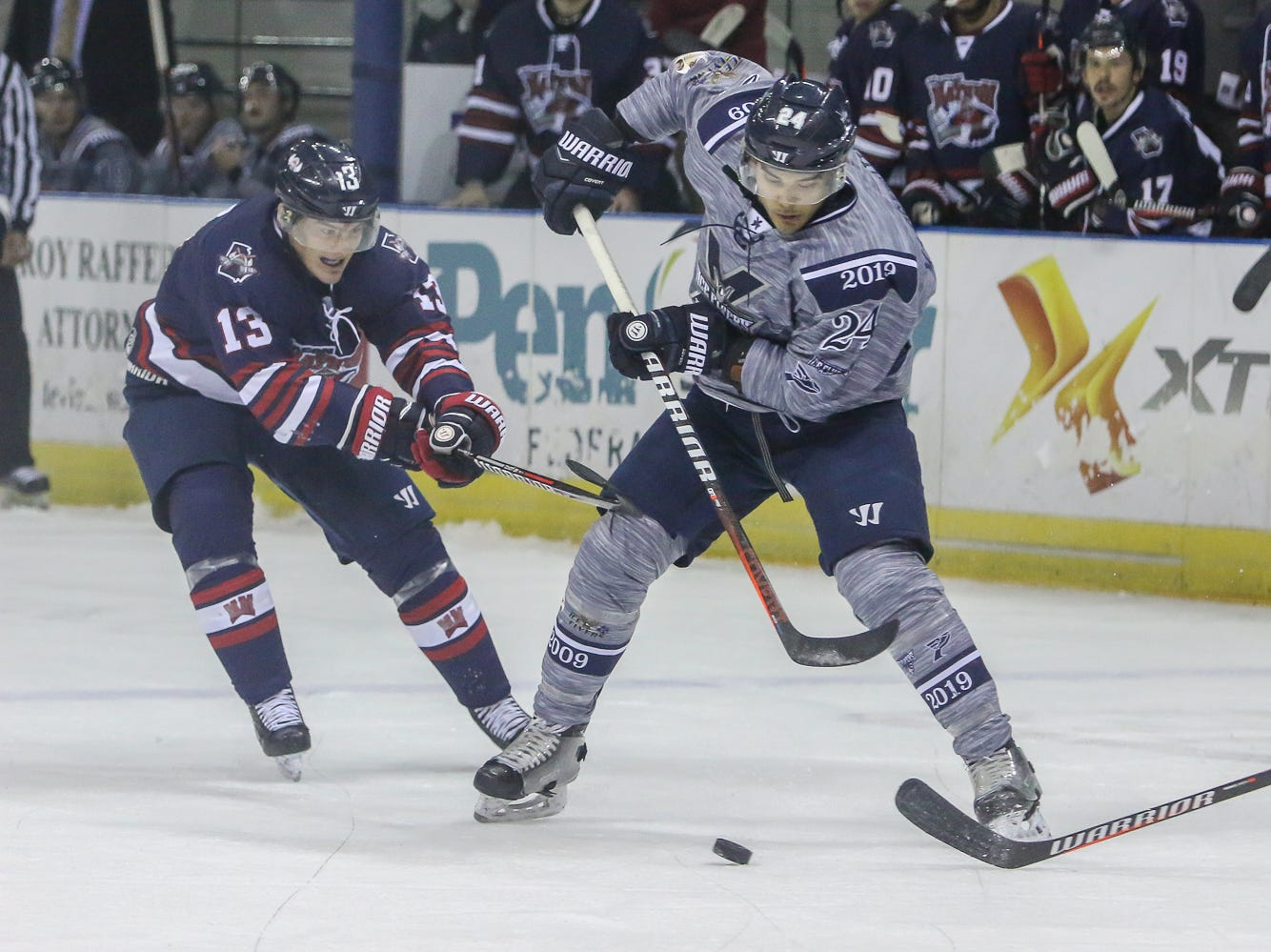 Pensacola's Eddie Matsushima (24) works to maintain control of the puck against Macon during the last home game of the regular season at the Pensacola Bay Center on Saturday, March 23, 2019. With over 4,300 people in attendance for Pensacola's 3-1 victory, the Ice Flyers mark six straight years of over 100,000 people at their home games each season. The team has won their last five games in a row and will finish out their last five games on the road before entering the playoffs in a couple of weeks.