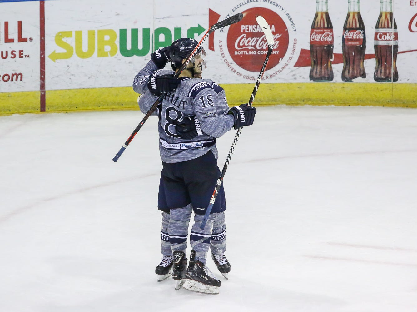 Pensacola's Andrew Schmit (18) celebrates after scoring an empty net goal against Macon during the last home game of the regular season at the Pensacola Bay Center on Saturday, March 23, 2019. With over 4,300 people in attendance for Pensacola's 3-1 victory, the Ice Flyers mark six straight years of over 100,000 people at their home games each season. The team has won their last five games in a row and will finish out their last five games on the road before entering the playoffs in a couple of weeks.