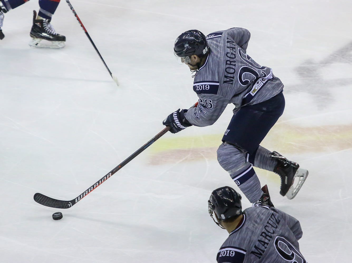 Pensacola's Brian Morgan (26) moves the puck up the ice against Macon during the last home game of the regular season at the Pensacola Bay Center on Saturday, March 23, 2019. With over 4,300 people in attendance for Pensacola's 3-1 victory, the Ice Flyers mark six straight years of over 100,000 people at their home games each season. The team has won their last five games in a row and will finish out their last five games on the road before entering the playoffs in a couple of weeks.