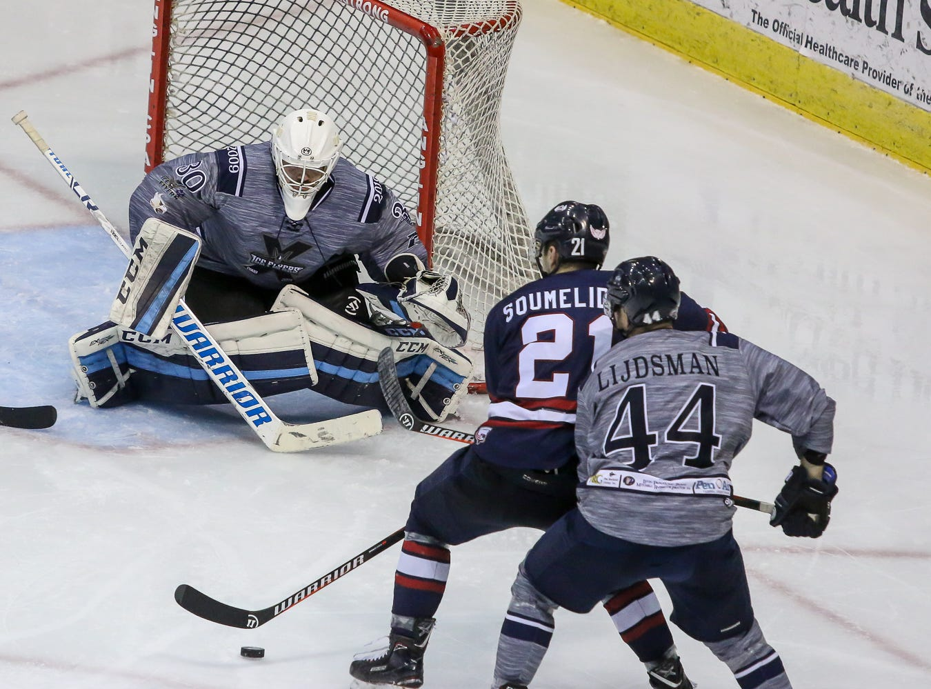 Pensacola goaltender Brian Billett (30) sets up to stop a possible shot by Macon's Stathis Soumelidis (21) during the last home game of the regular season at the Pensacola Bay Center on Saturday, March 23, 2019. With over 4,300 people in attendance for Pensacola's 3-1 victory, the Ice Flyers mark six straight years of over 100,000 people at their home games each season. The team has won their last five games in a row and will finish out their last five games on the road before entering the playoffs in a couple of weeks.