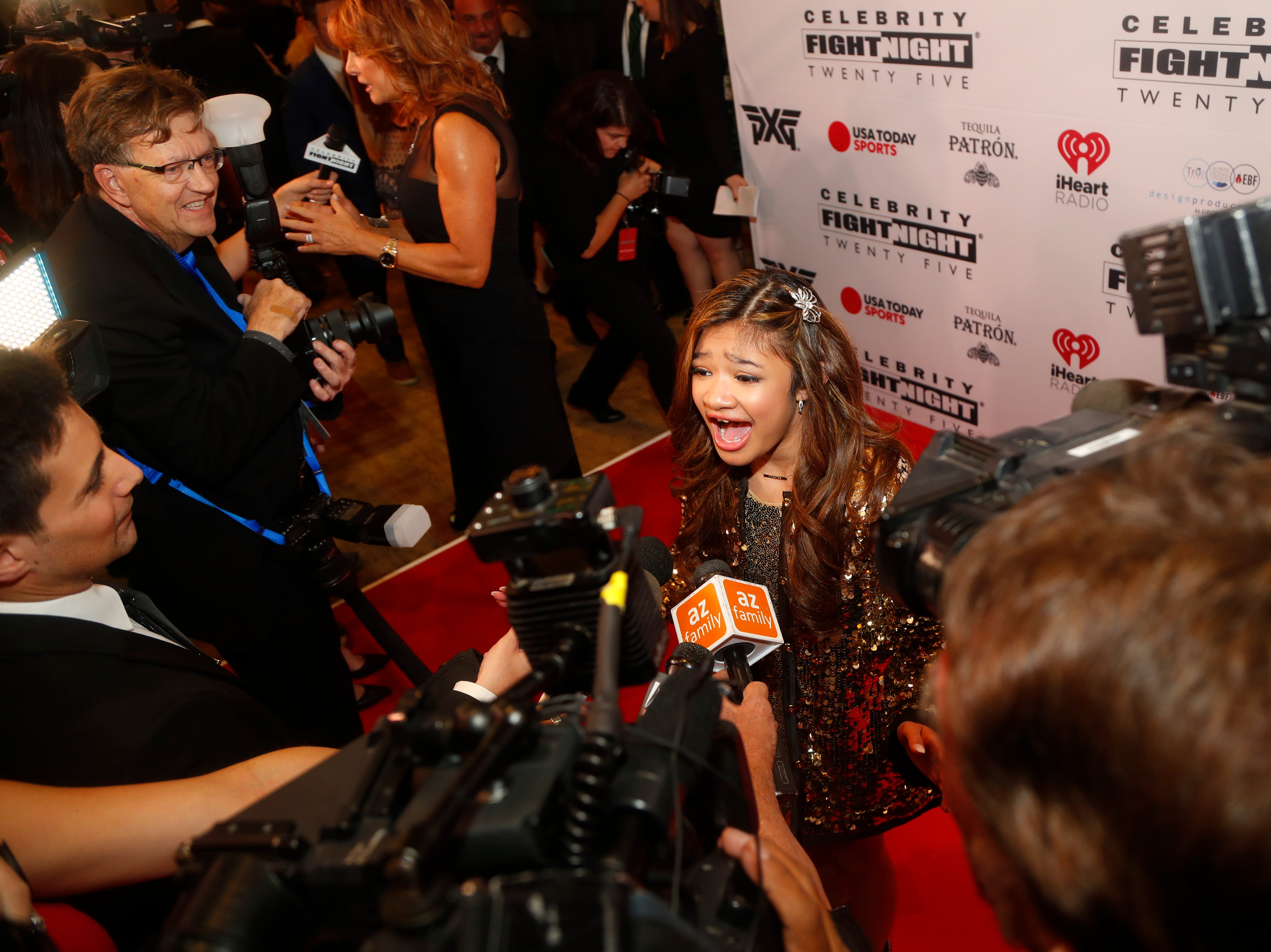Angelica Hale sings in an interview during the Celebrity Fight Night red carpet in Scottsdale, Ariz., on March 23, 2019.