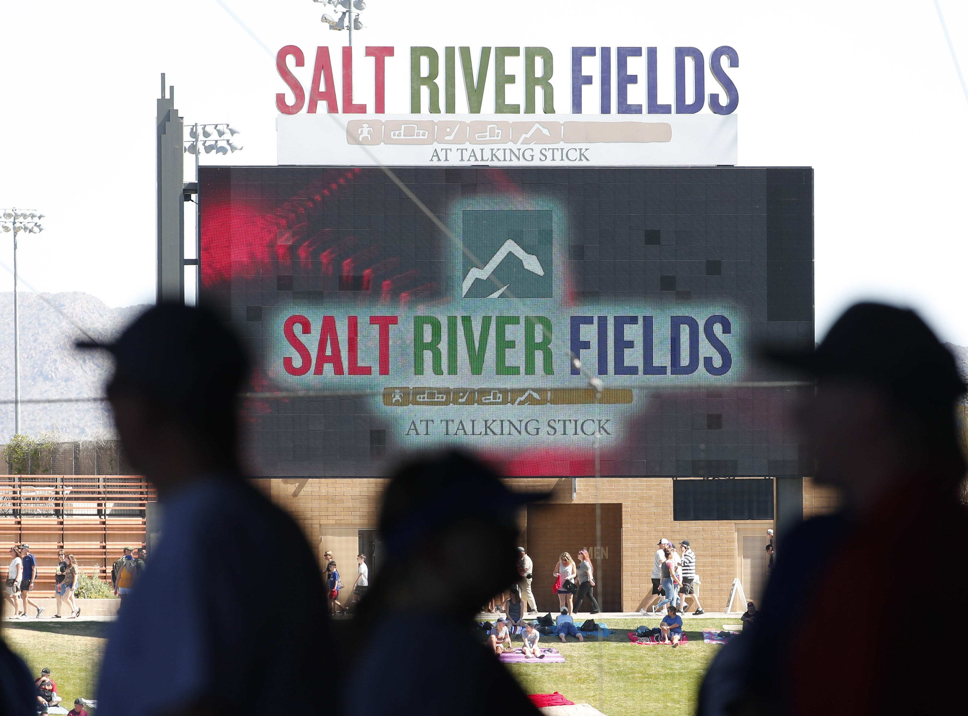 Fans walk along the concourse during a spring training between the Arizona Diamondbacks and the Milwaukee Brewers at Salt River Fields at Talking Stick March 24, 2019.
