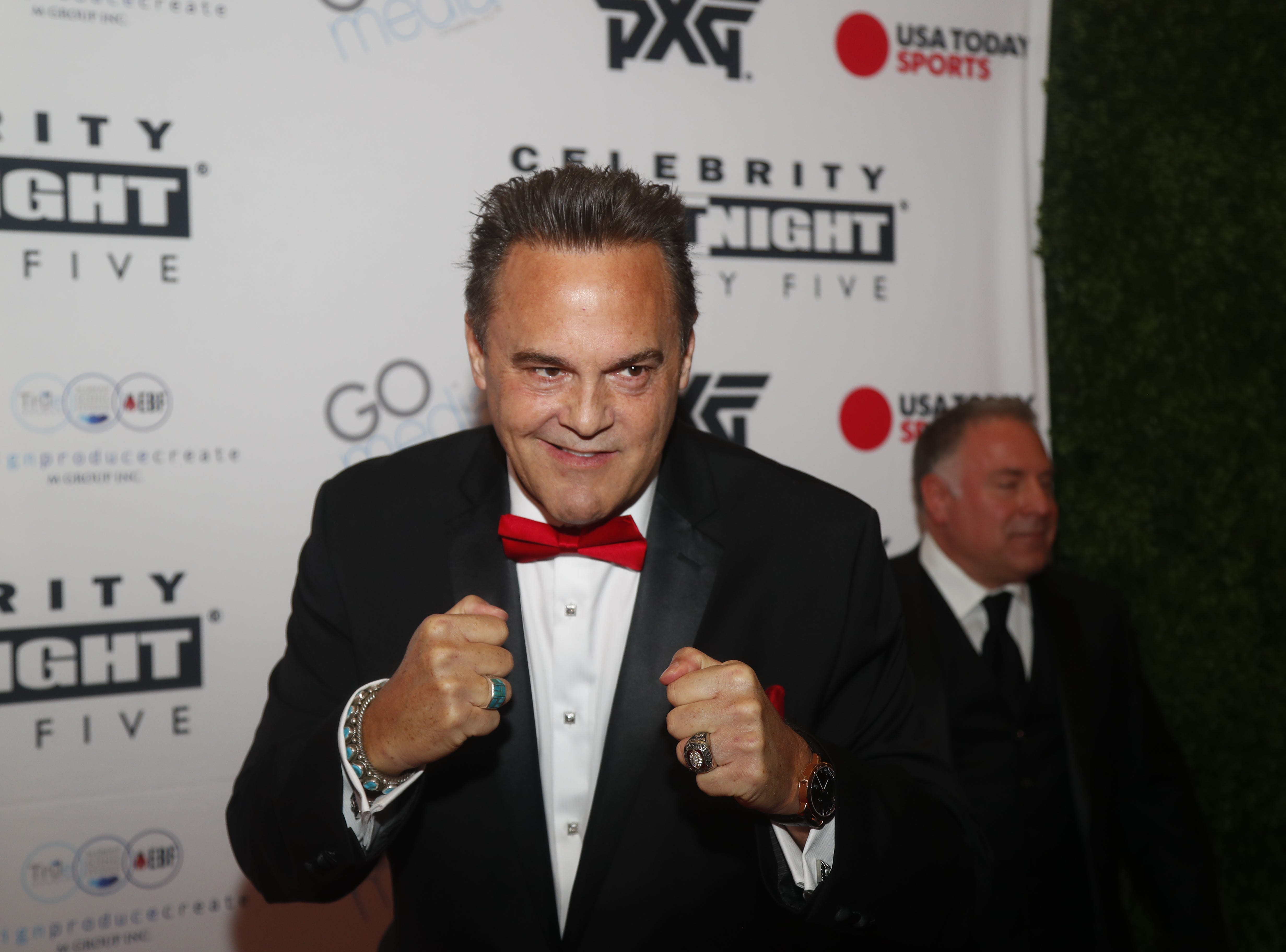 Nick Lowery poses for pictures during the Celebrity Fight Night red carpet in Scottsdale, Ariz., on March 23, 2019.