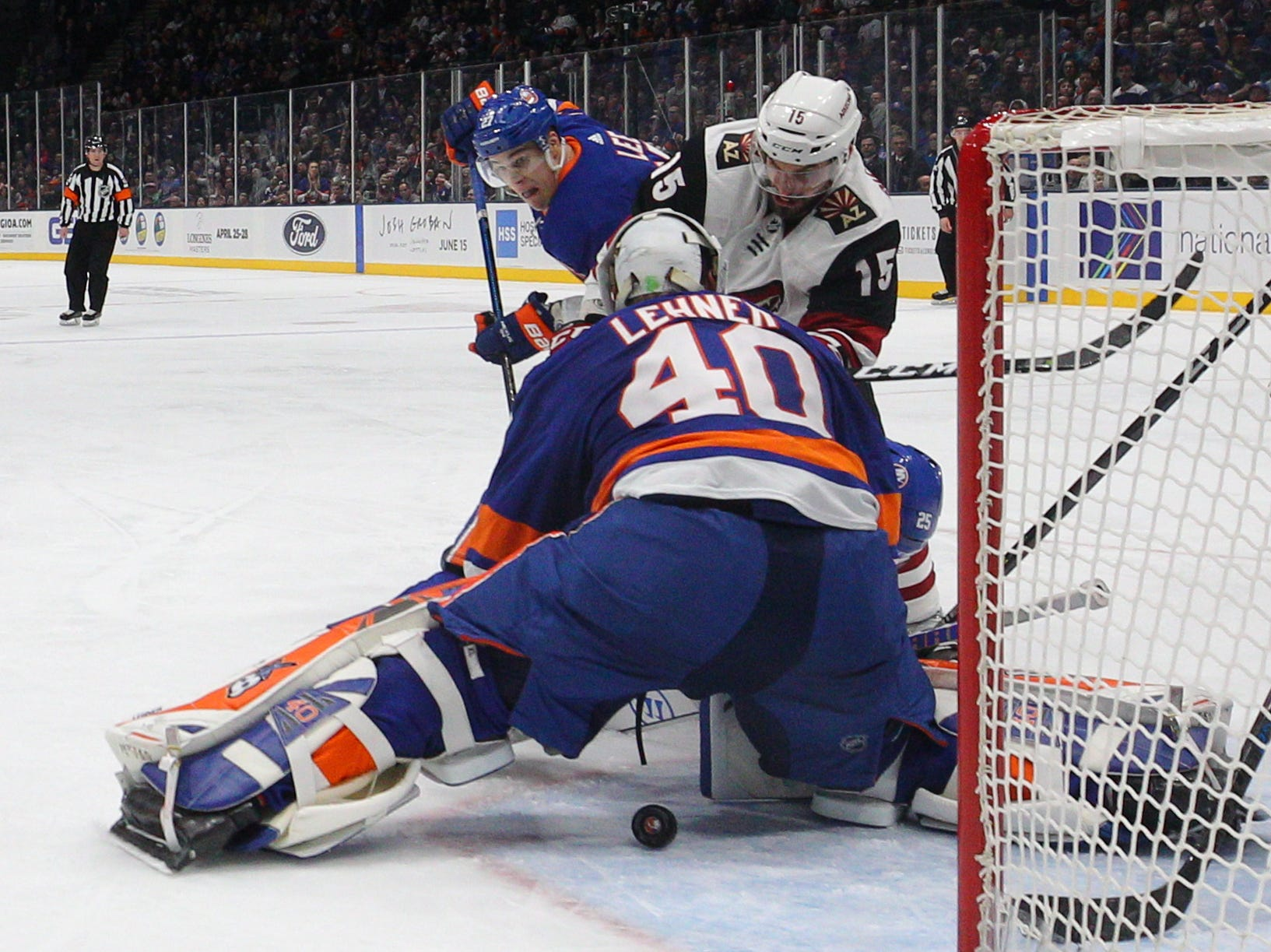 Mar 24, 2019; Uniondale, NY, USA; Arizona Coyotes center Brad Richardson (15) shoots against New York Islanders goalie Robin Lehner (40) during the third period at Nassau Veterans Memorial Coliseum. Mandatory Credit: Brad Penner-USA TODAY Sports