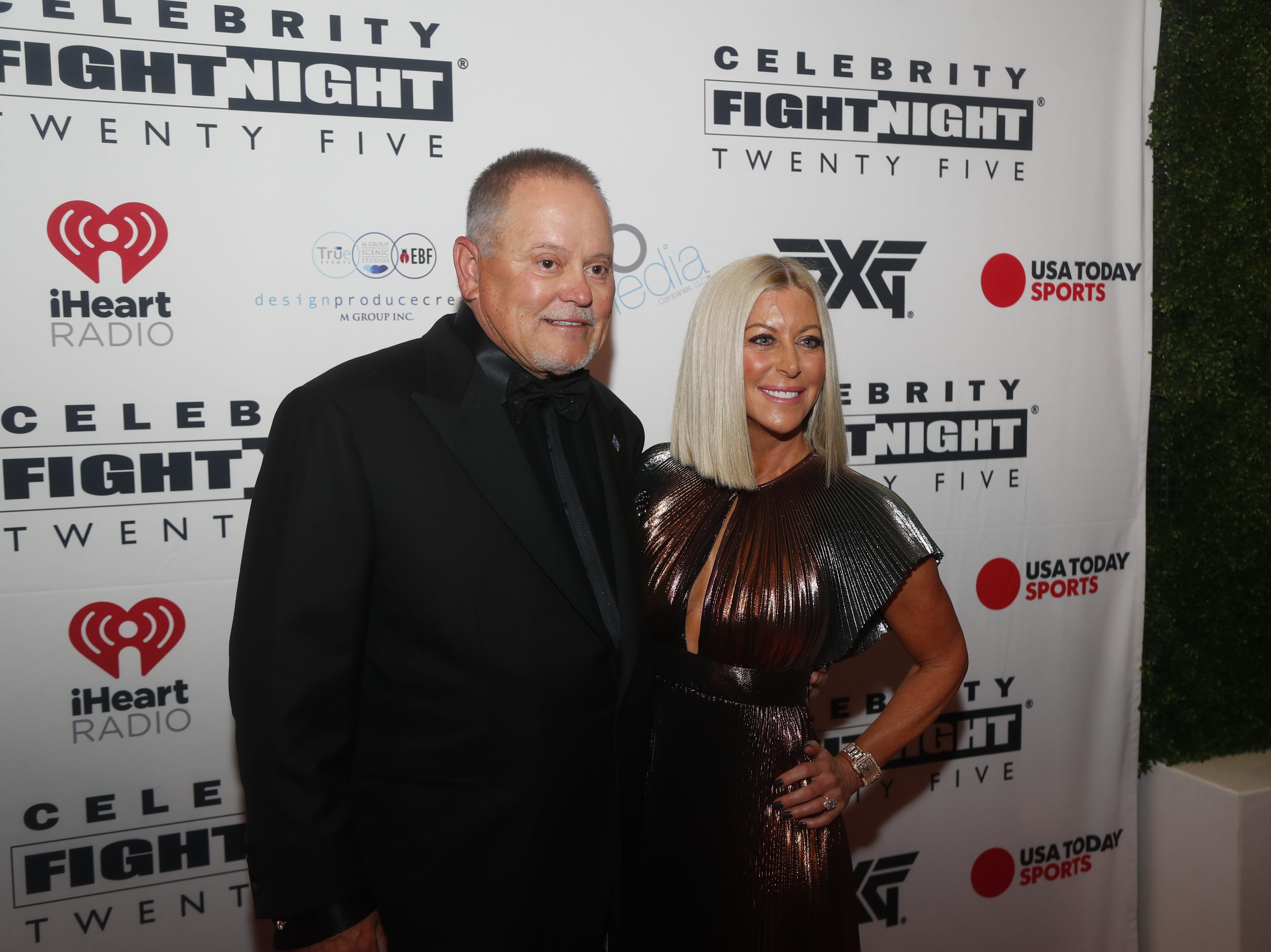 Renee and Bob Parsons poses for pictures during the Celebrity Fight Night red carpet in Scottsdale, Ariz., on March 23, 2019.