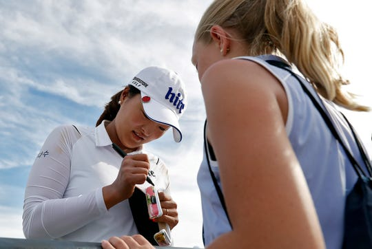 Jin Young Ko signs an autograph after the third round of the Founders Cup LPGA golf tournament on Saturday in Phoenix.