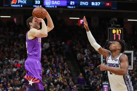 Mar 23, 2019; Sacramento, CA, USA; Phoenix Suns guard Jimmer Fredette (32) shoots the ball against Sacramento Kings guard Buddy Hield (24) during the second quarter at Golden 1 Center.