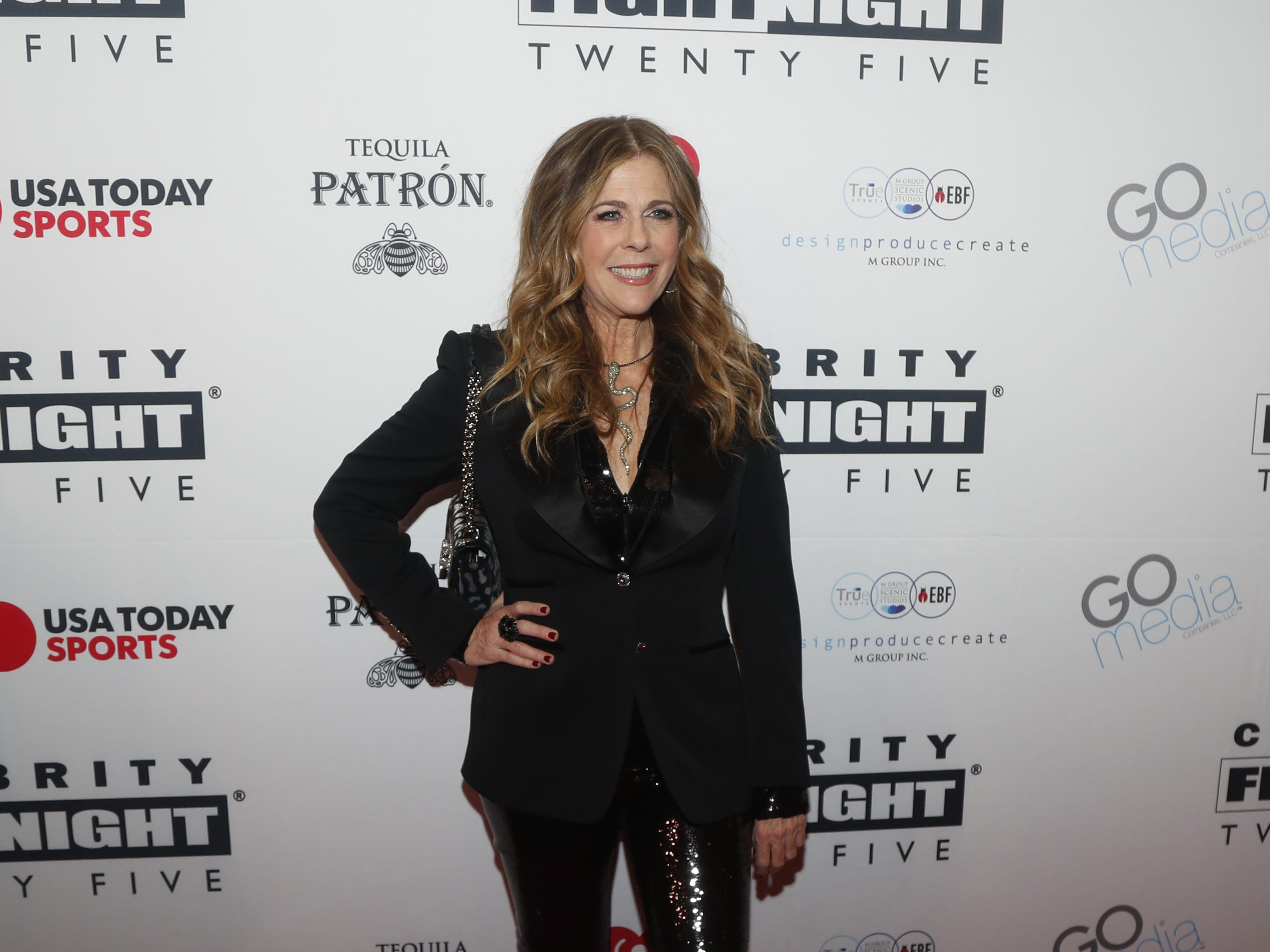 Rita Wilson poses for pictures during the Celebrity Fight Night red carpet in Scottsdale, Ariz., on March 23, 2019.