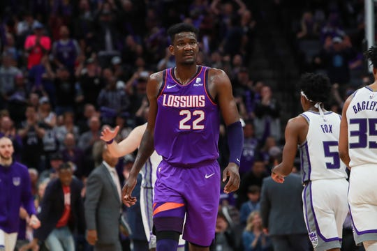 Deandre Ayton walks off the court during a game against the Kings on March 23 at the Golden 1 Center.