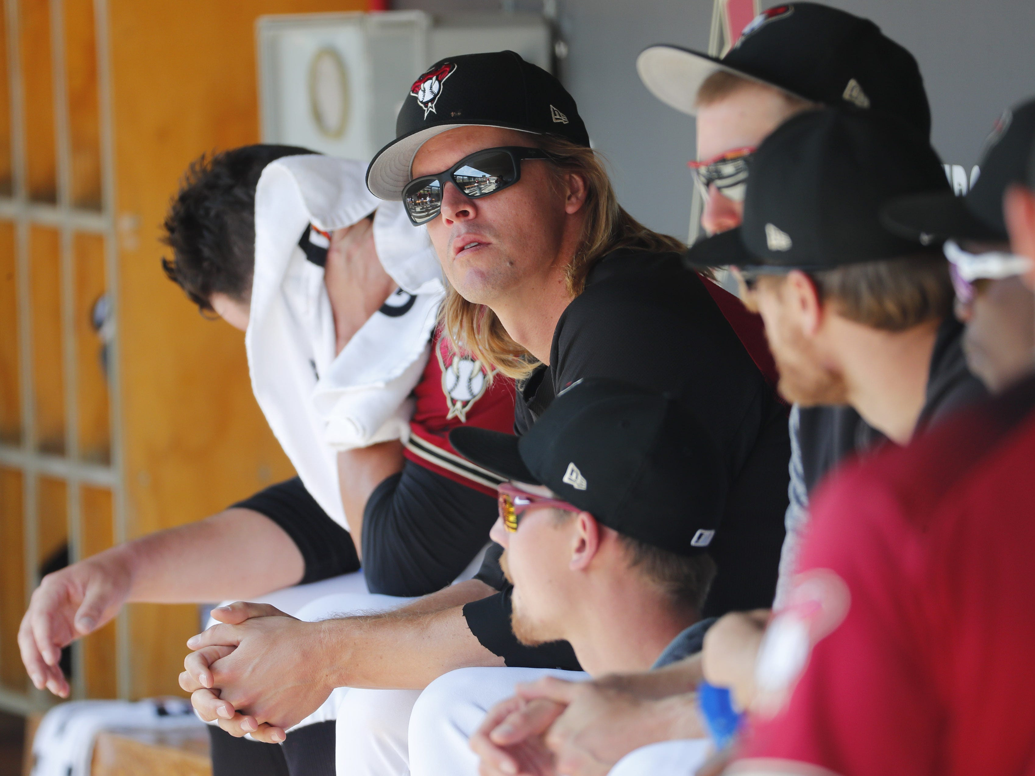 Arizona Diamondbacks starting pitcher Zack Greinke (21) watches a game against the Milwaukee Brewers during spring training at Salt River Fields at Talking Stick March 24, 2019.