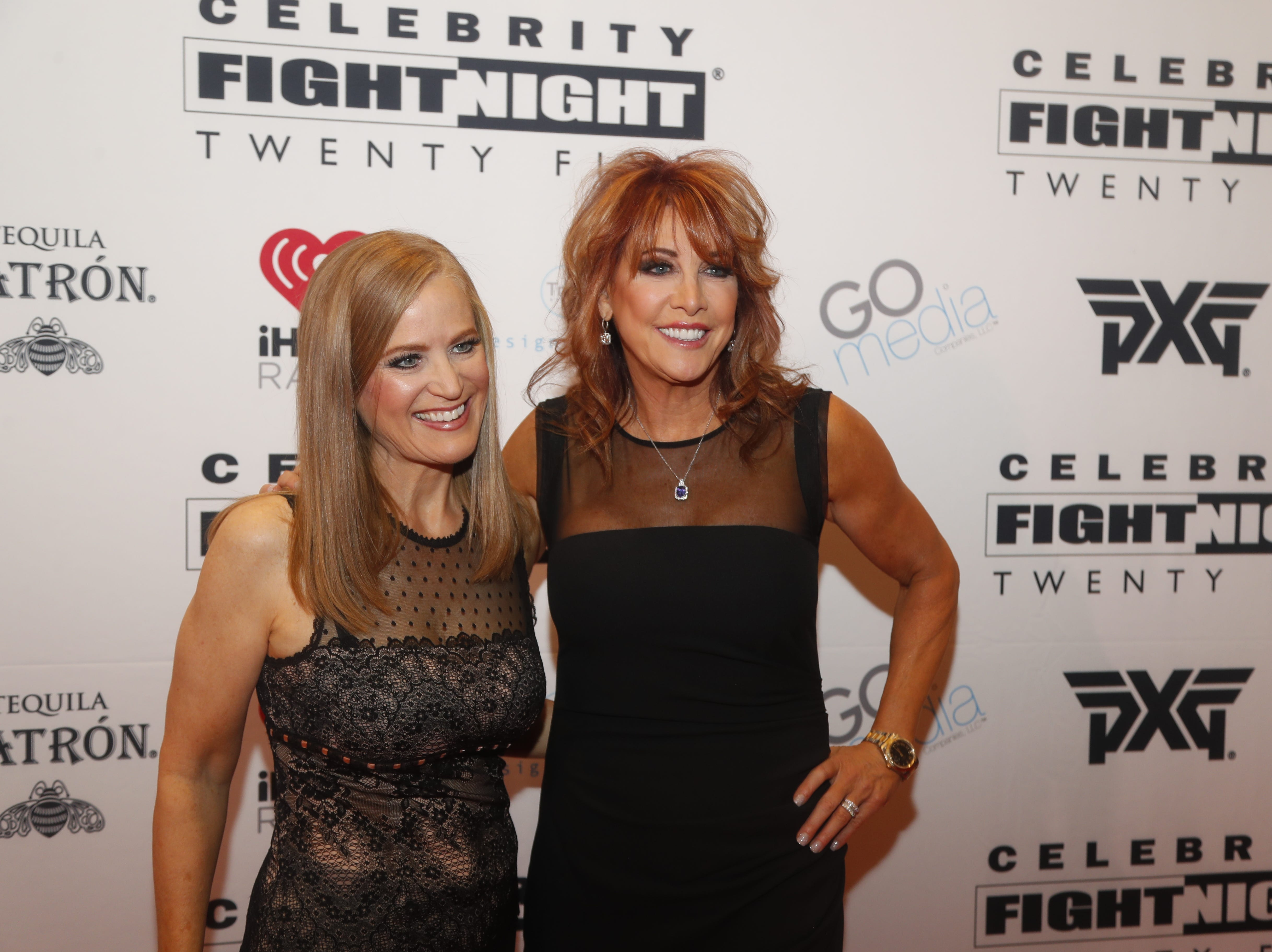 Nancy Lieberman (right) poses for pictures during the Celebrity Fight Night red carpet in Scottsdale, Ariz., on March 23, 2019.