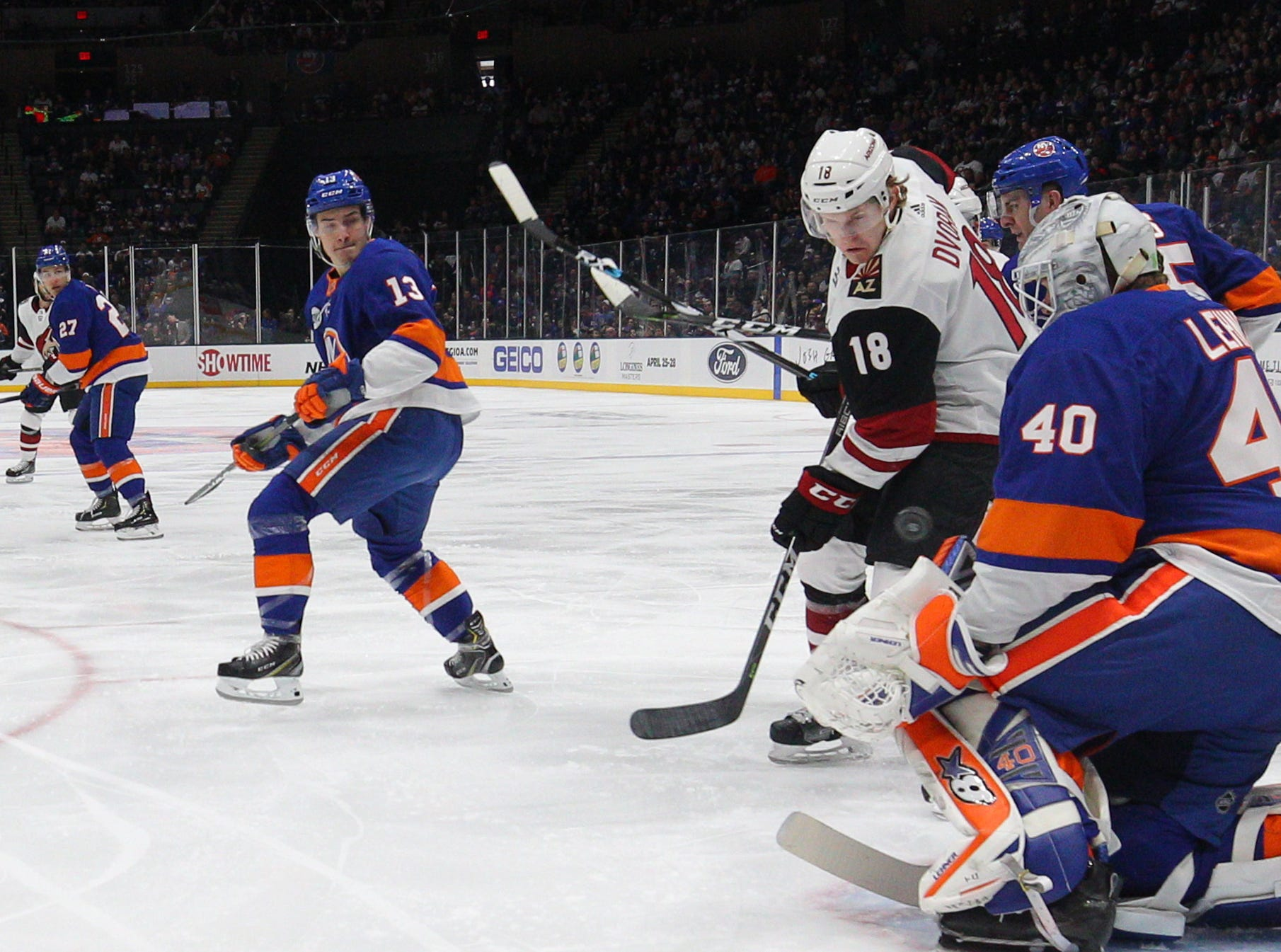 Islanders goalie Robin Lehner (40) makes a save in front of Coyotes center Christian Dvorak (18) during the first period of a game at Nassau Veterans Memorial Coliseum.