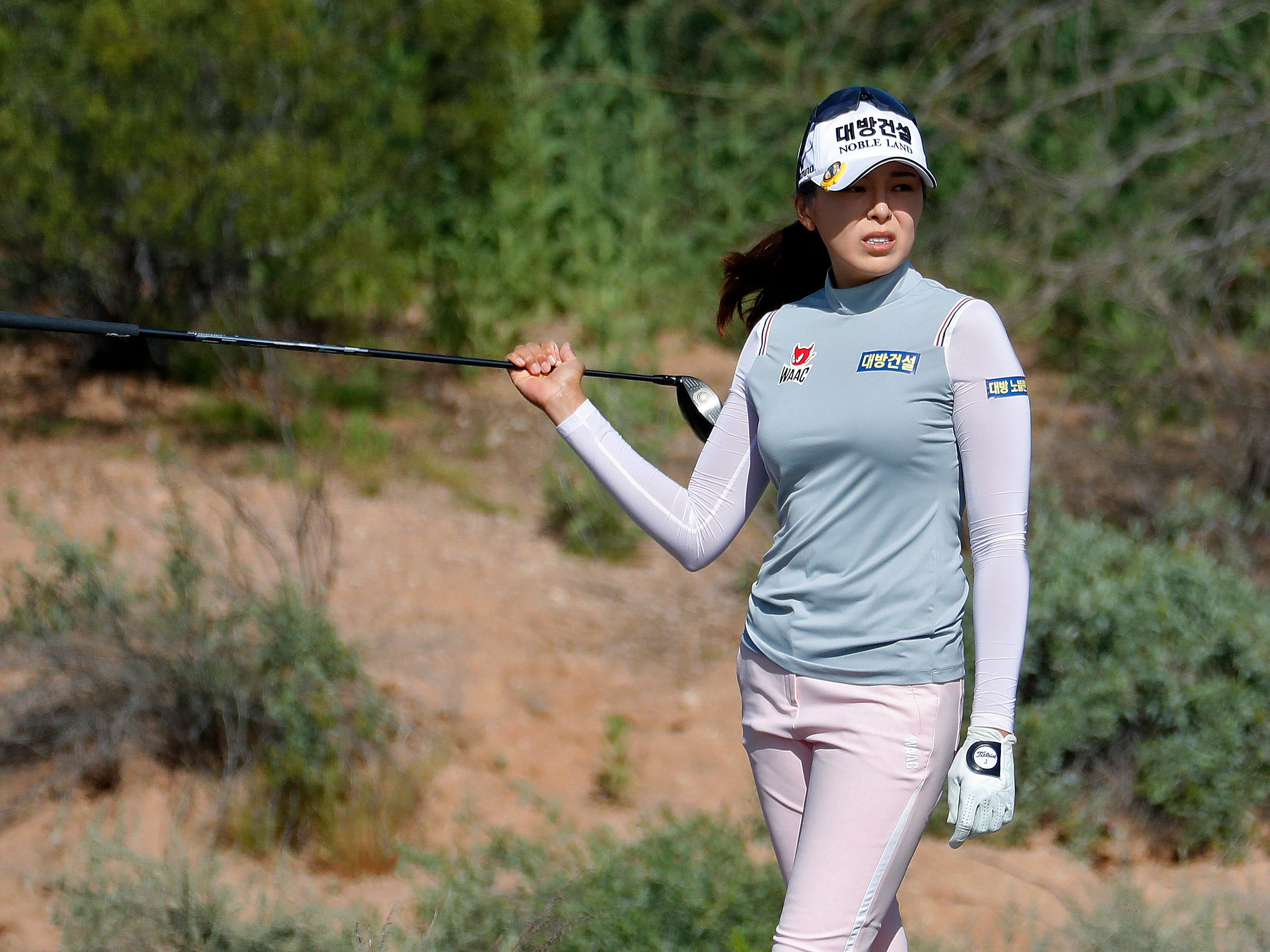 Mi Jung Hur looks for her ball in the desert on the seventh fairway during the third round of the Founders Cup LPGA golf tournament, Saturday, March 23, 2019, in Phoenix. Hur bogeyed the hole.