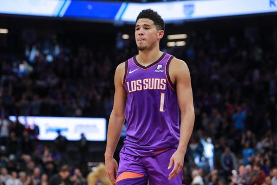 Mar 23, 2019; Sacramento, CA, USA; Phoenix Suns guard Devin Booker (1) walks off the court after the game against the Sacramento Kings at Golden 1 Center.