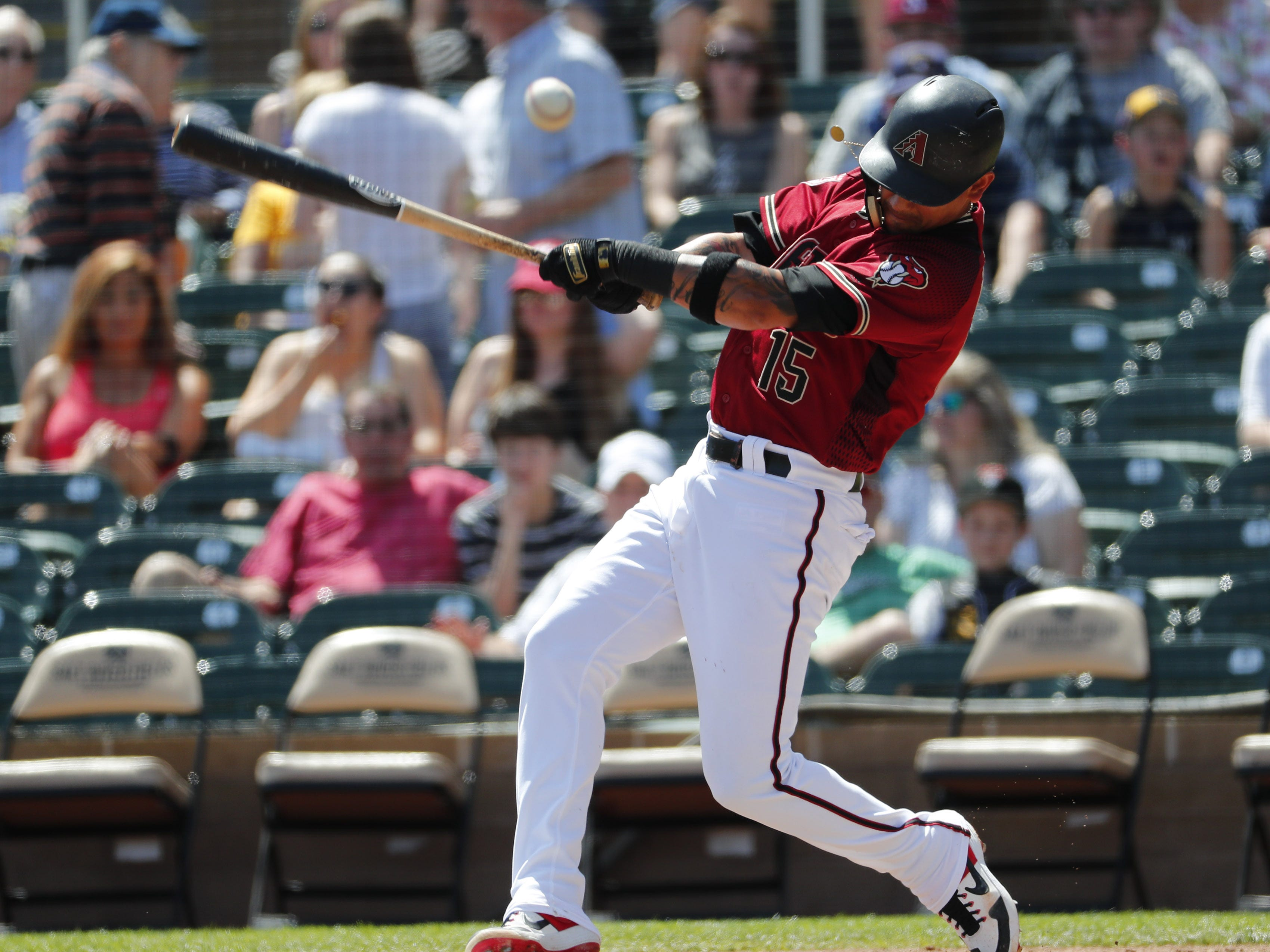 Arizona Diamondbacks second baseman Ildemaro Vargas (15) fouls the ball off during spring training against the Milwaukee Brewers at Salt River Fields at Talking Stick March 24, 2019.