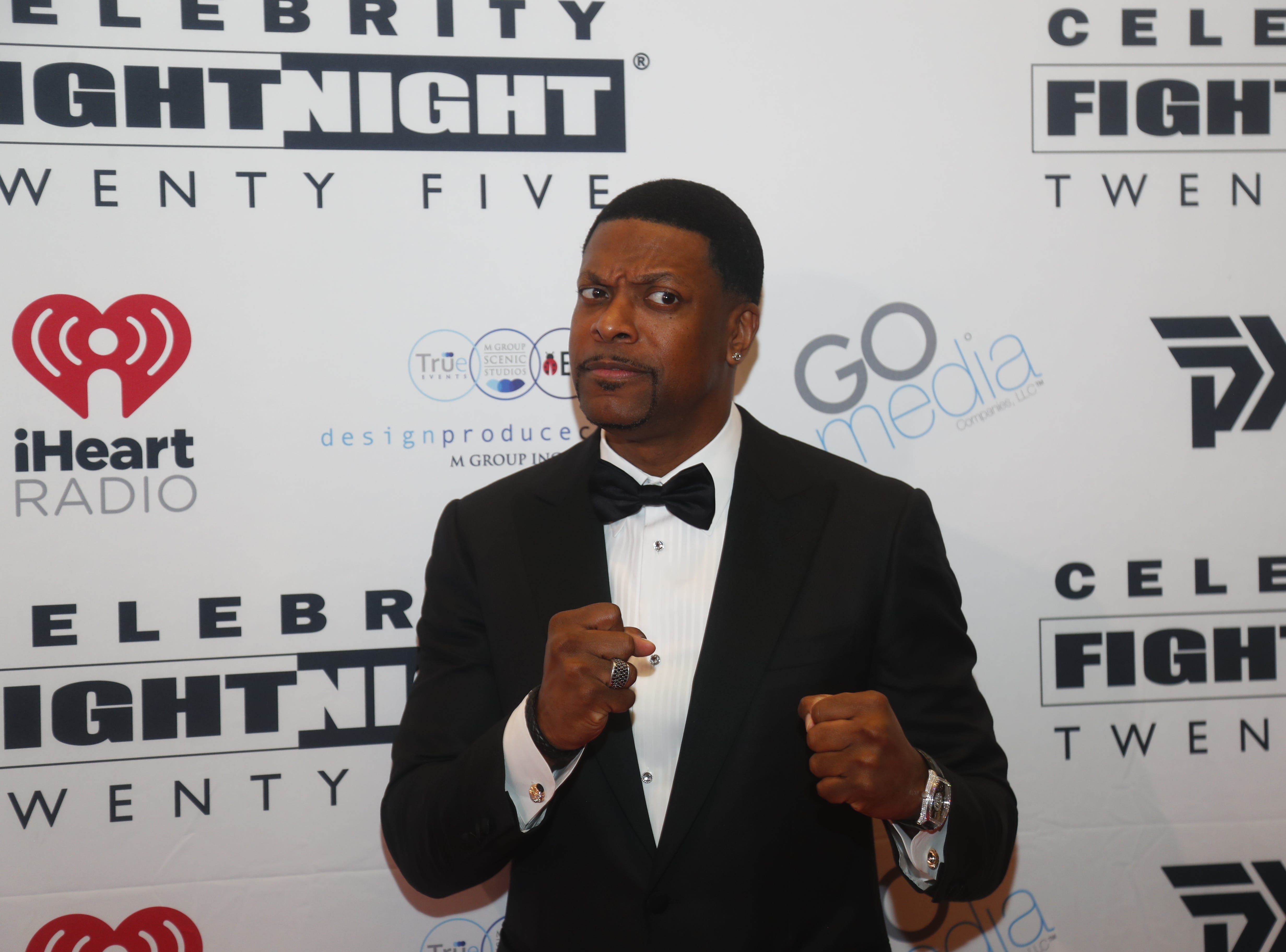 Chris Tucker poses for pictures during the Celebrity Fight Night red carpet in Scottsdale, Ariz., on March 23, 2019.