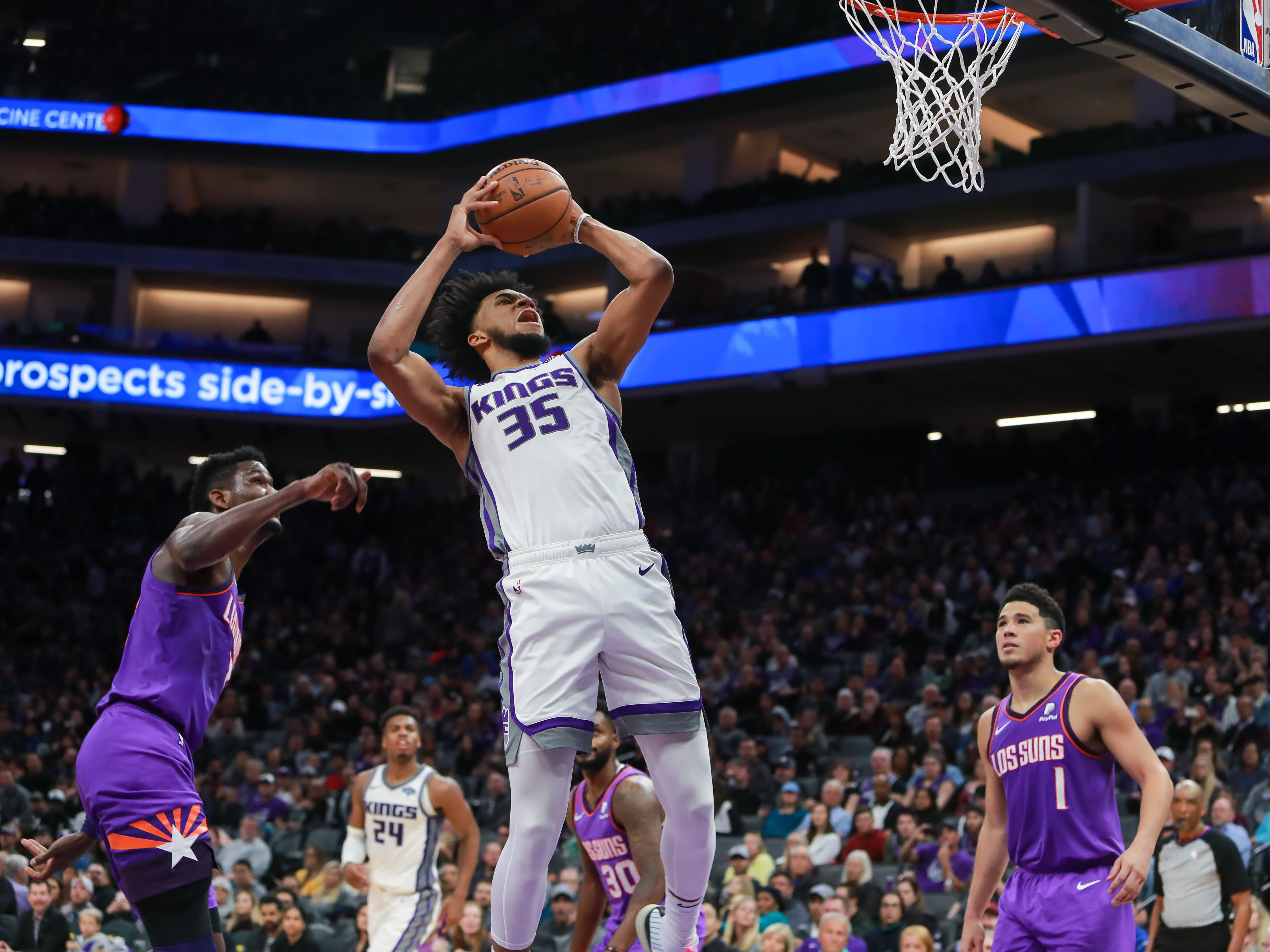 Mar 23, 2019; Sacramento, CA, USA; Sacramento Kings forward Marvin Bagley III (35) grabs a rebound against Phoenix Suns center Deandre Ayton (22) during the fourth quarter at Golden 1 Center.