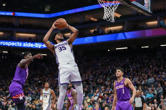 Kings forward Marvin Bagley III grabs a rebound during a game against the Suns on March 23.