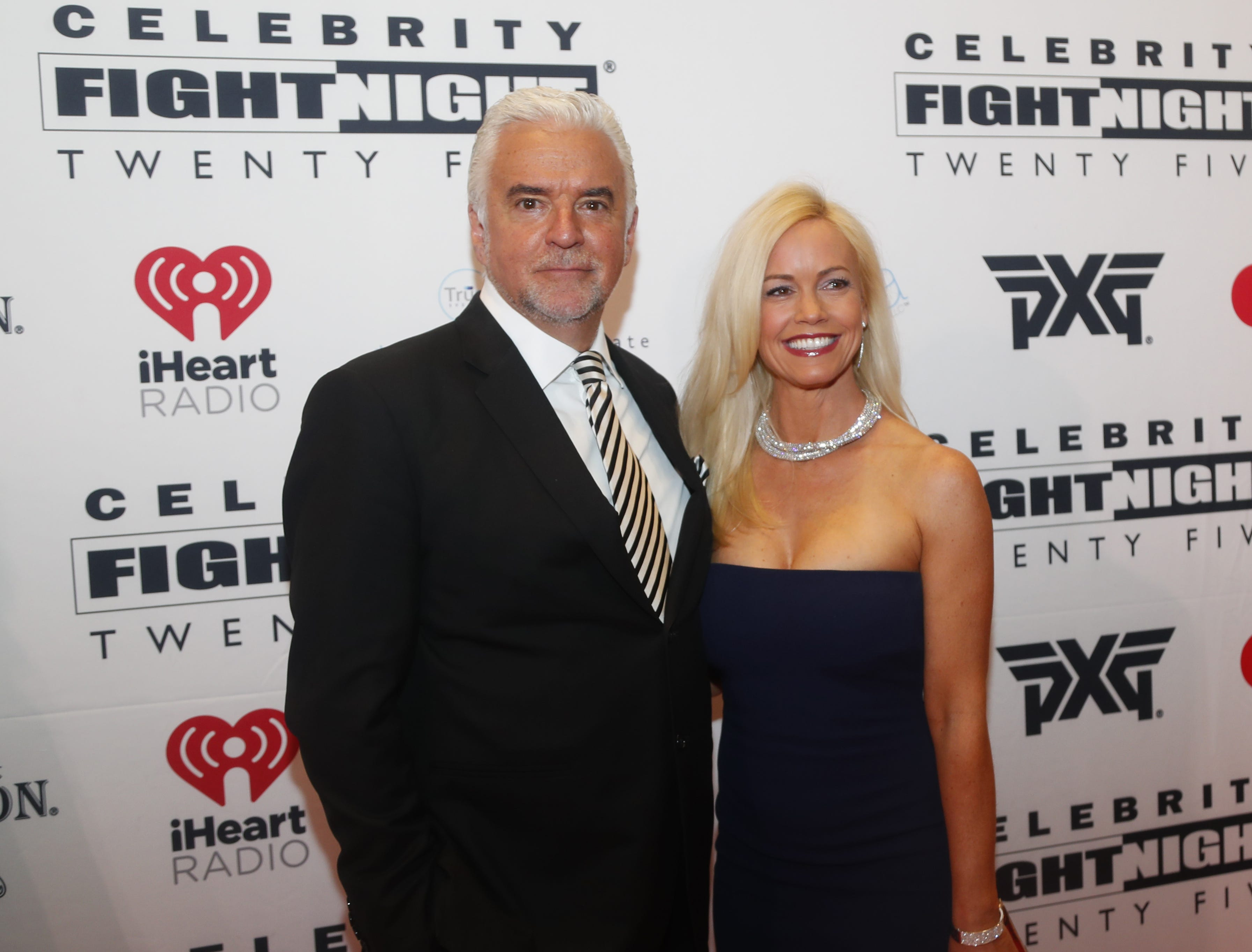 John O'Hurley poses with his date during the Celebrity Fight Night red carpet in Scottsdale, Ariz., on March 23, 2019.