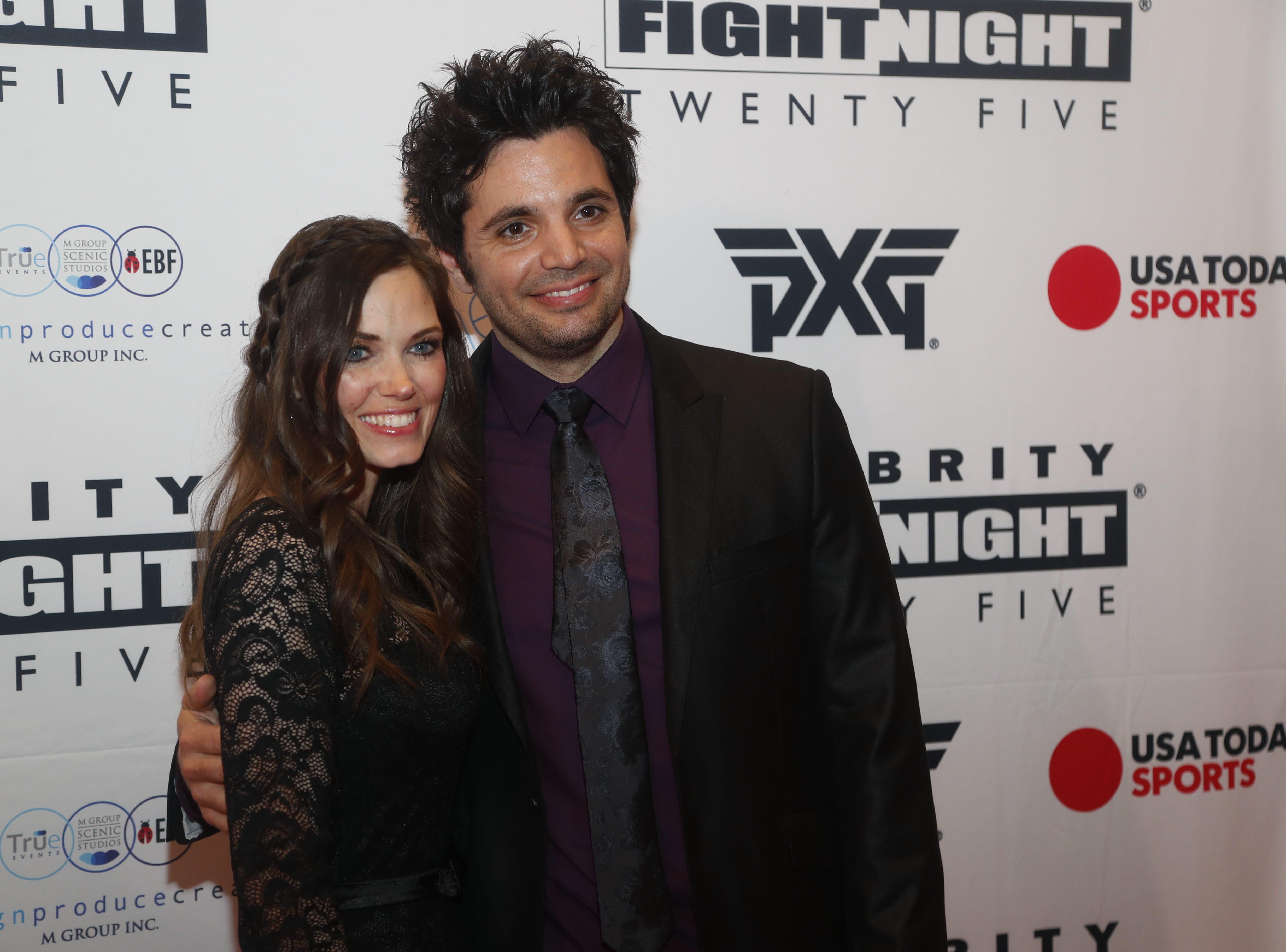 William Joseph poses for pictures with his date during the Celebrity Fight Night red carpet in Scottsdale, Ariz., on March 23, 2019.