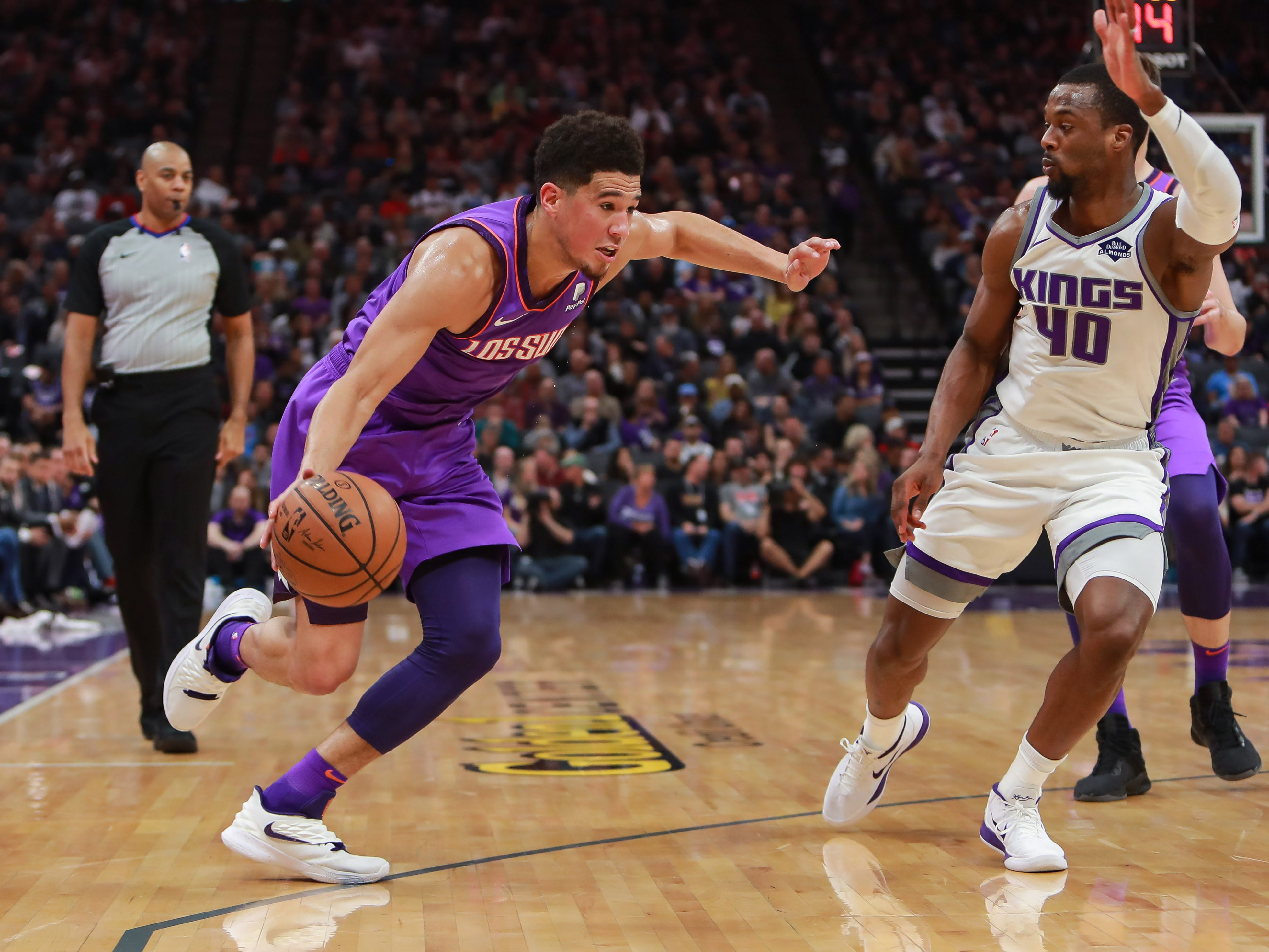 Mar 23, 2019; Sacramento, CA, USA; Phoenix Suns guard Devin Booker (1) dribbles the ball against Sacramento Kings forward Harrison Barnes (40) during the first quarter at Golden 1 Center.