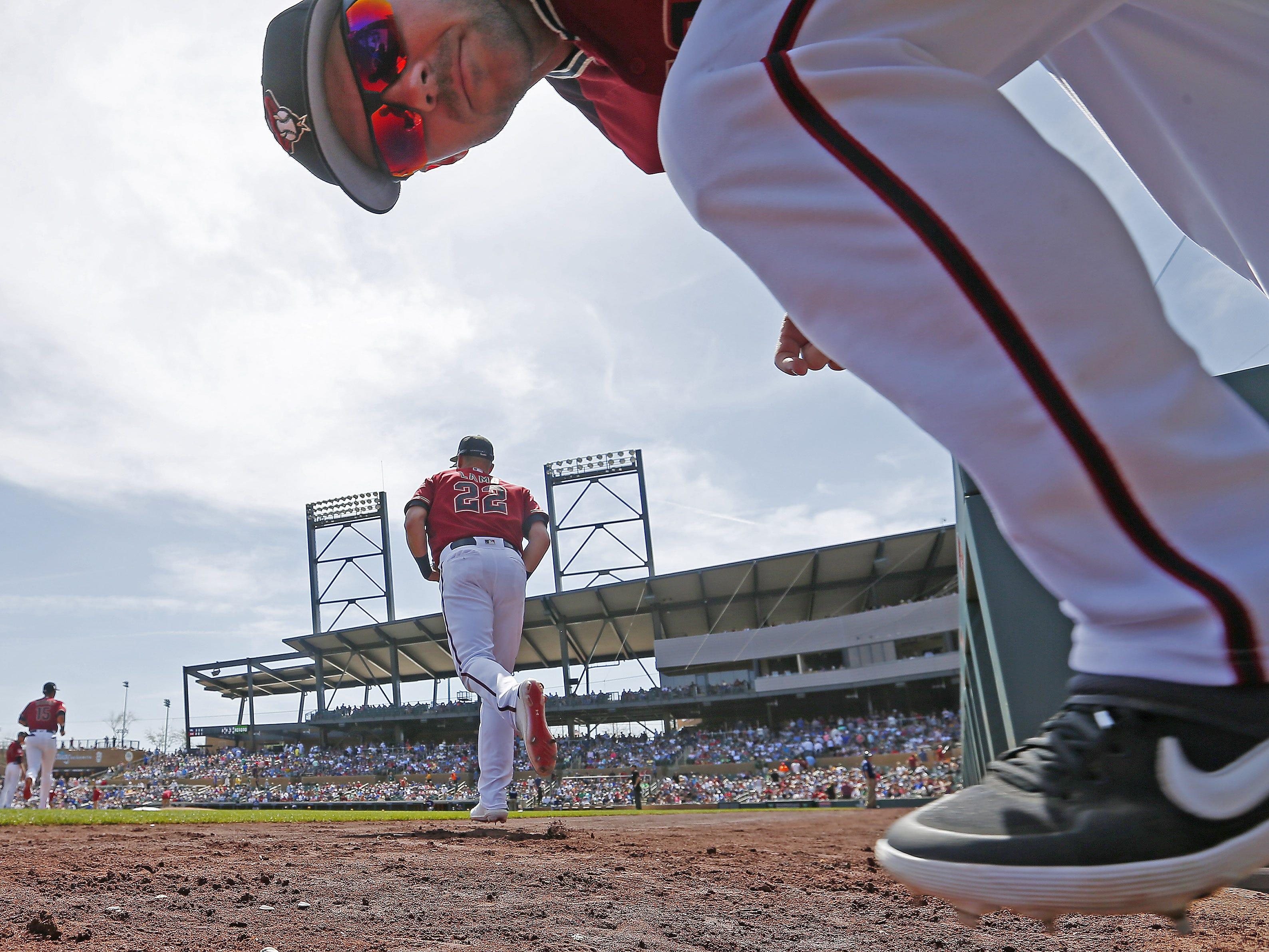 Arizona Diamondbacks LF Matt Szczur takes the field against the Milwaukee Brewers during spring training at Salt River Fields at Talking Stick March 24, 2019.