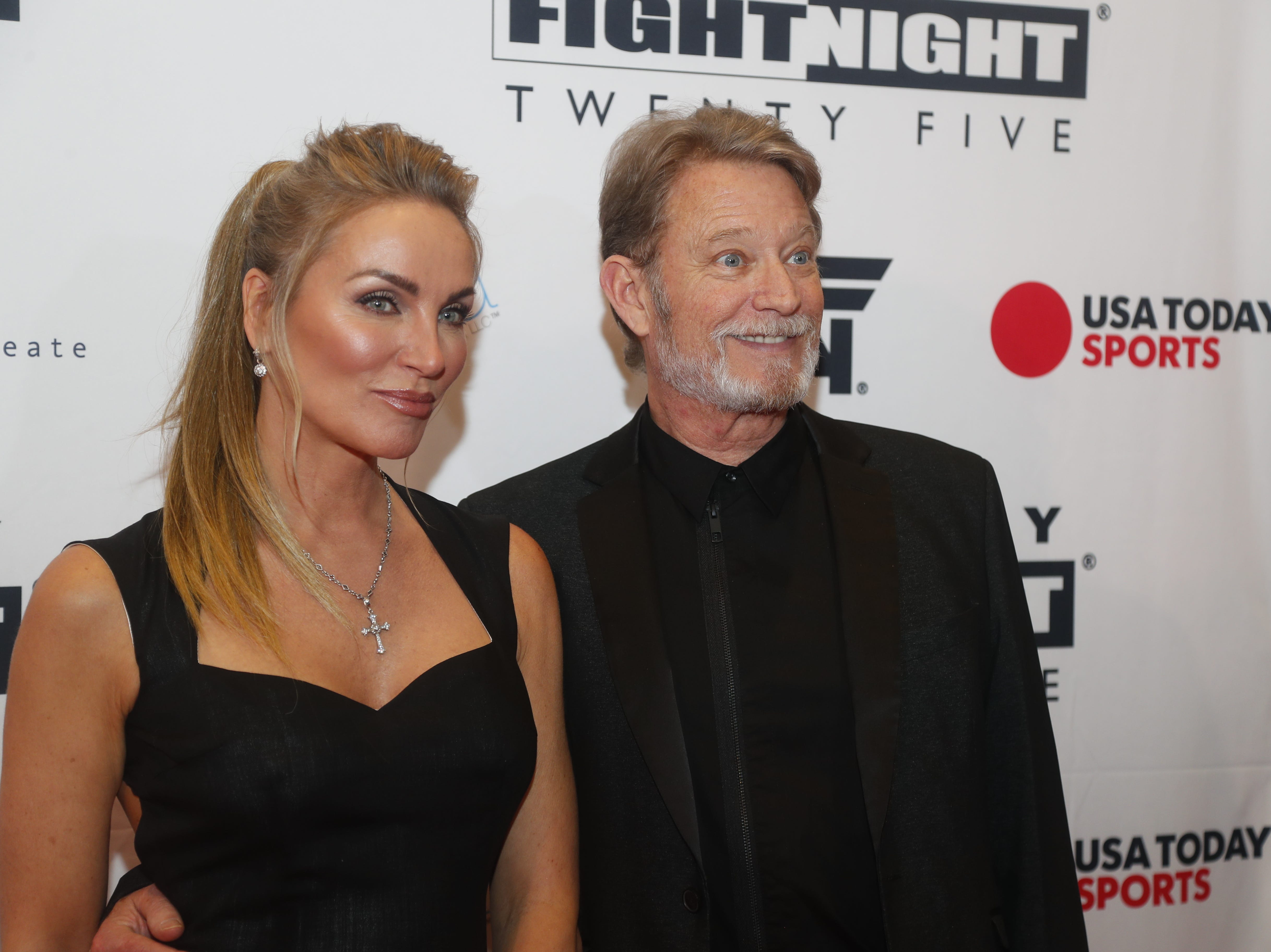 Chris Rich poses for pictures during the Celebrity Fight Night red carpet in Scottsdale, Ariz., on March 23, 2019.