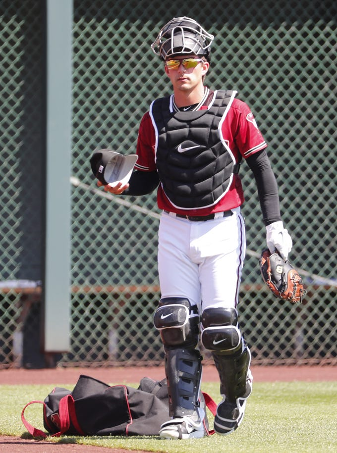 Arizona Diamondbacks catcher John Ryan Murphy (36) prepares to play against the Milwaukee Brewers during spring training at Salt River Fields at Talking Stick March 24, 2019.