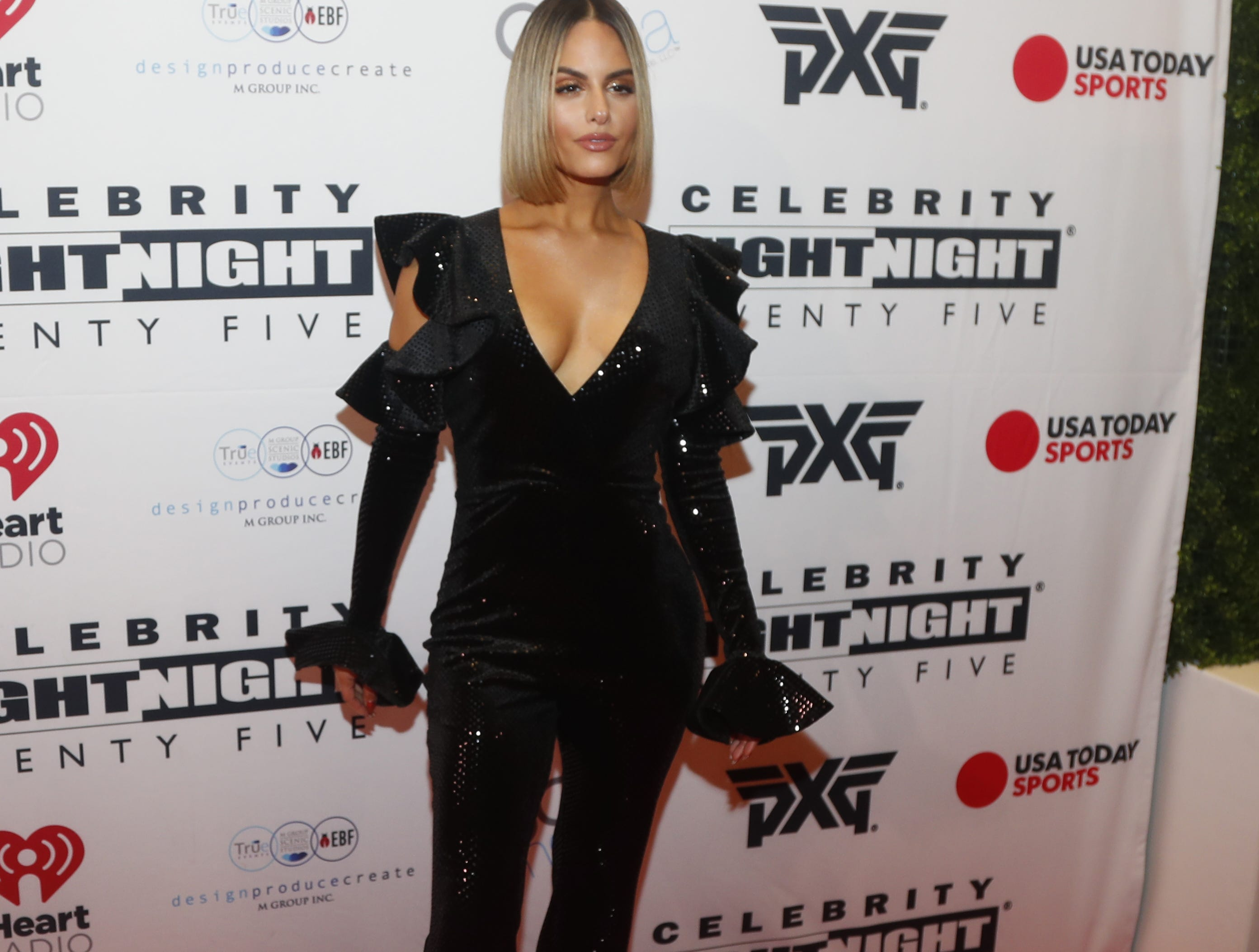 Pia Toscano poses for pictures during the Celebrity Fight Night red carpet in Scottsdale, Ariz., on March 23, 2019.