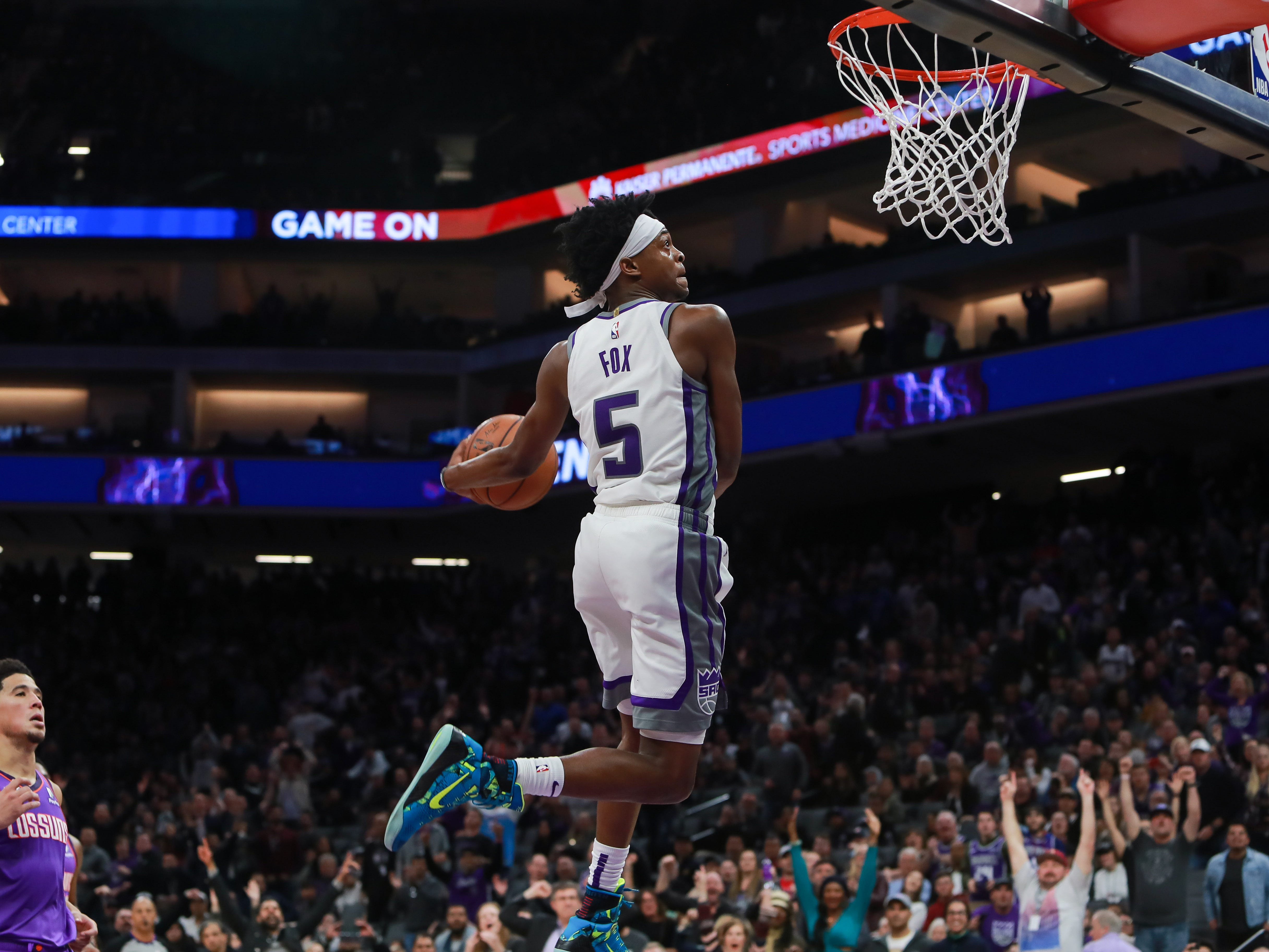 Mar 23, 2019; Sacramento, CA, USA; Sacramento Kings guard De'Aaron Fox (5) dunks the ball against the Phoenix Suns during the fourth quarter at Golden 1 Center.